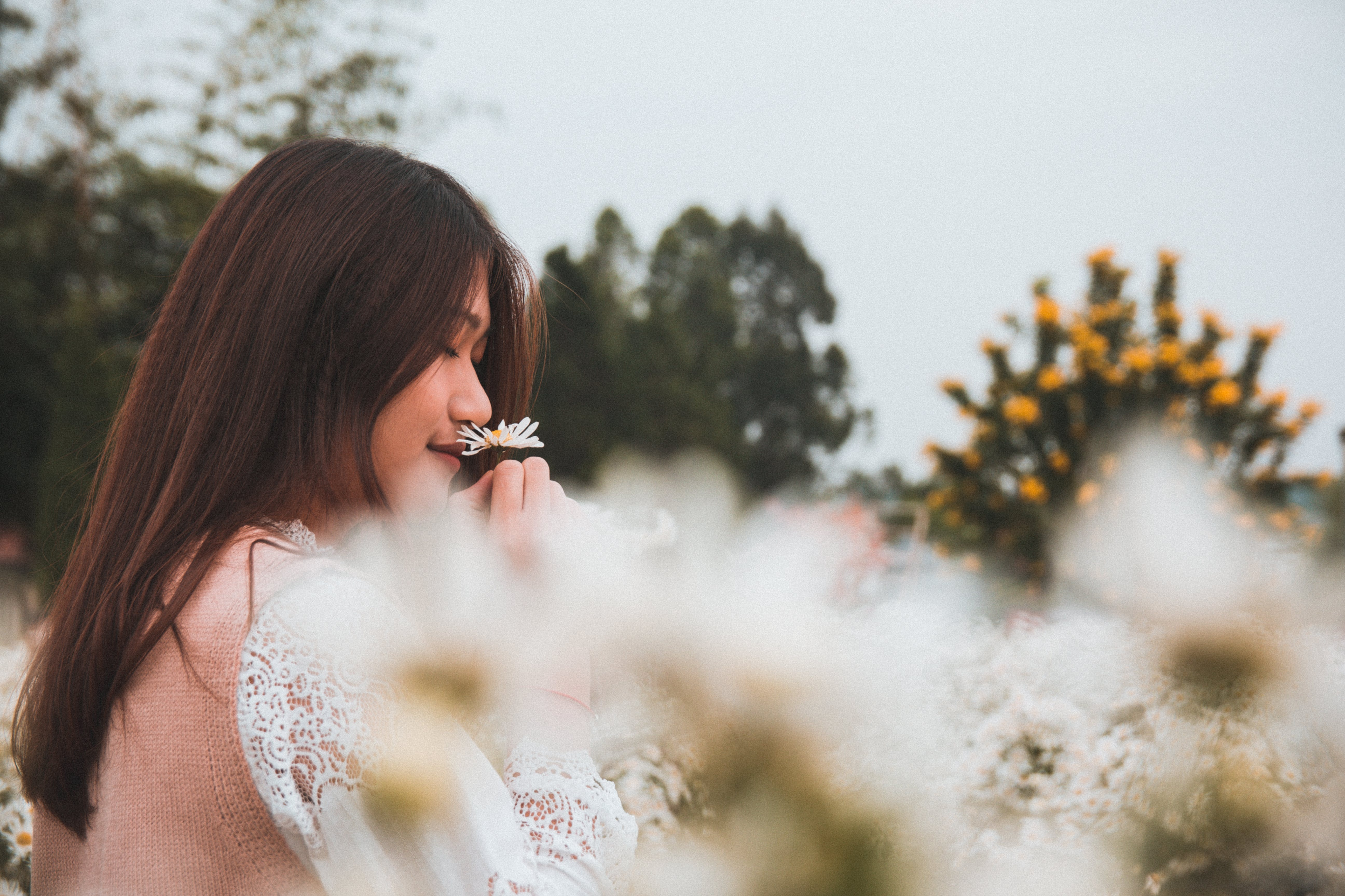 Woman Smelling Flower