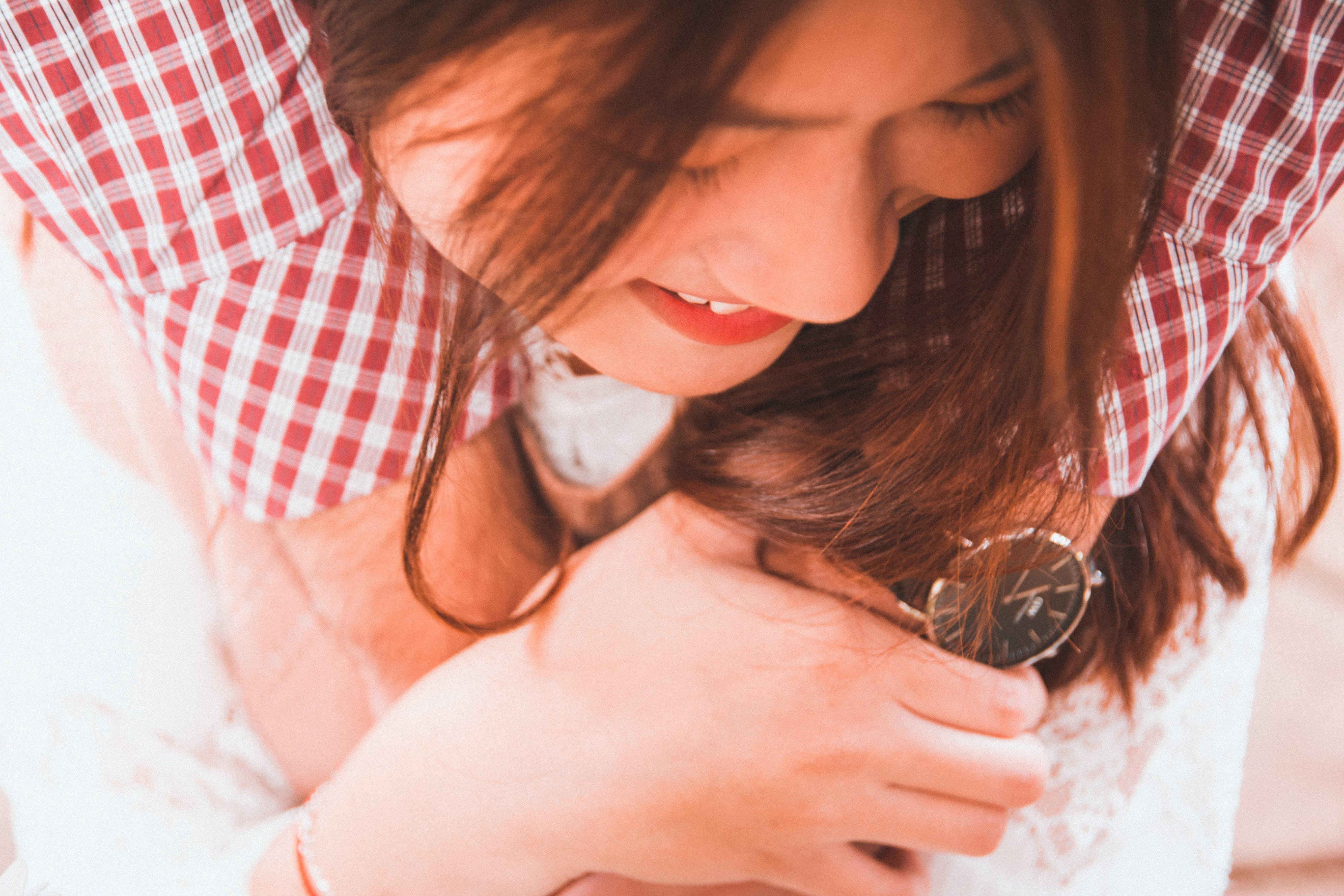 Woman Holding Round Black Analog Watch