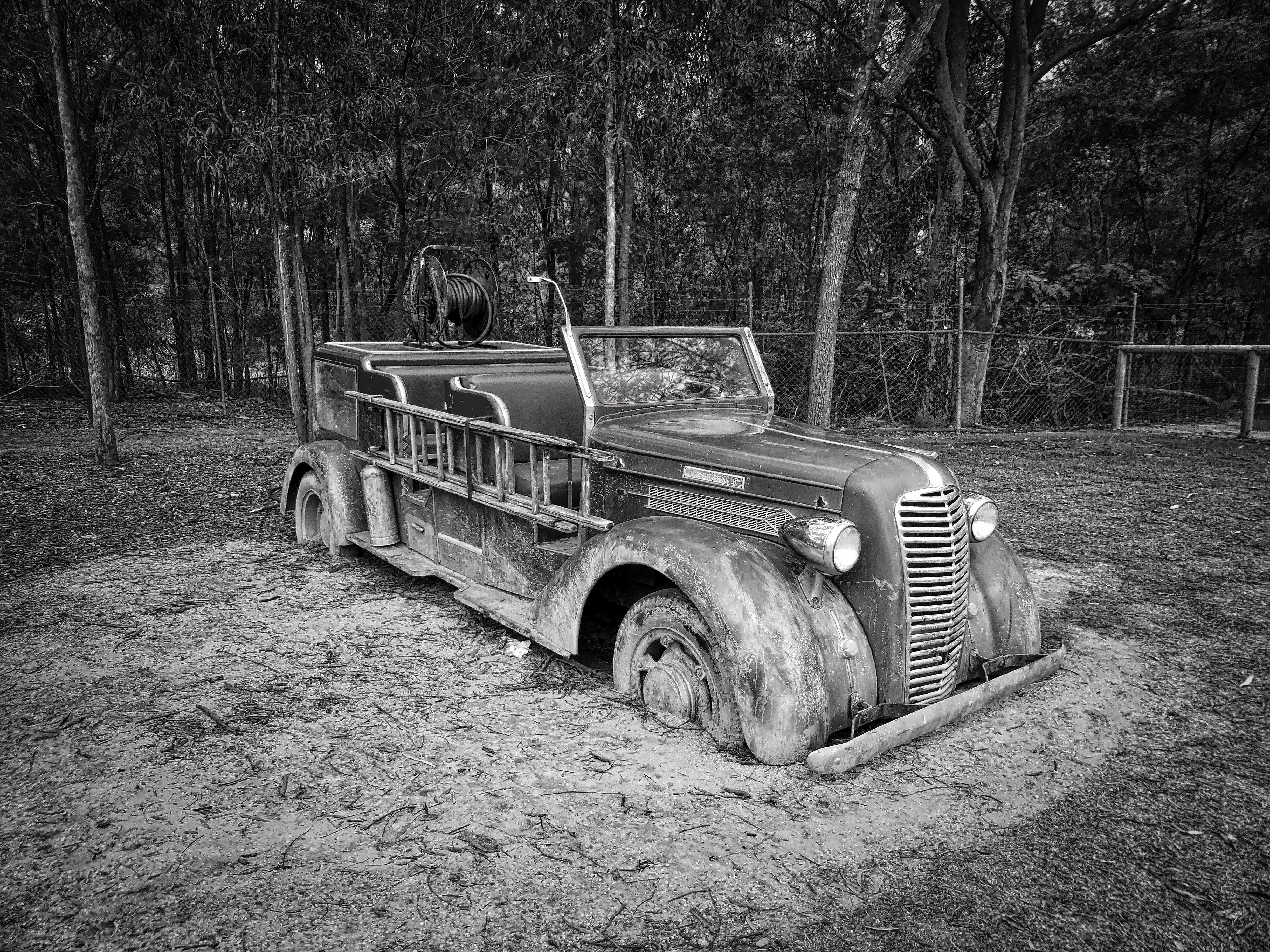 Gray Scale Photo of Vintage Car
