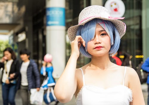 Selective Focus Photography of Woman Cosplaying Re:zero Rem