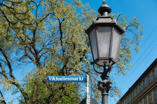 Viktualienmarkt Signage Beside Black Street Light during Daytime