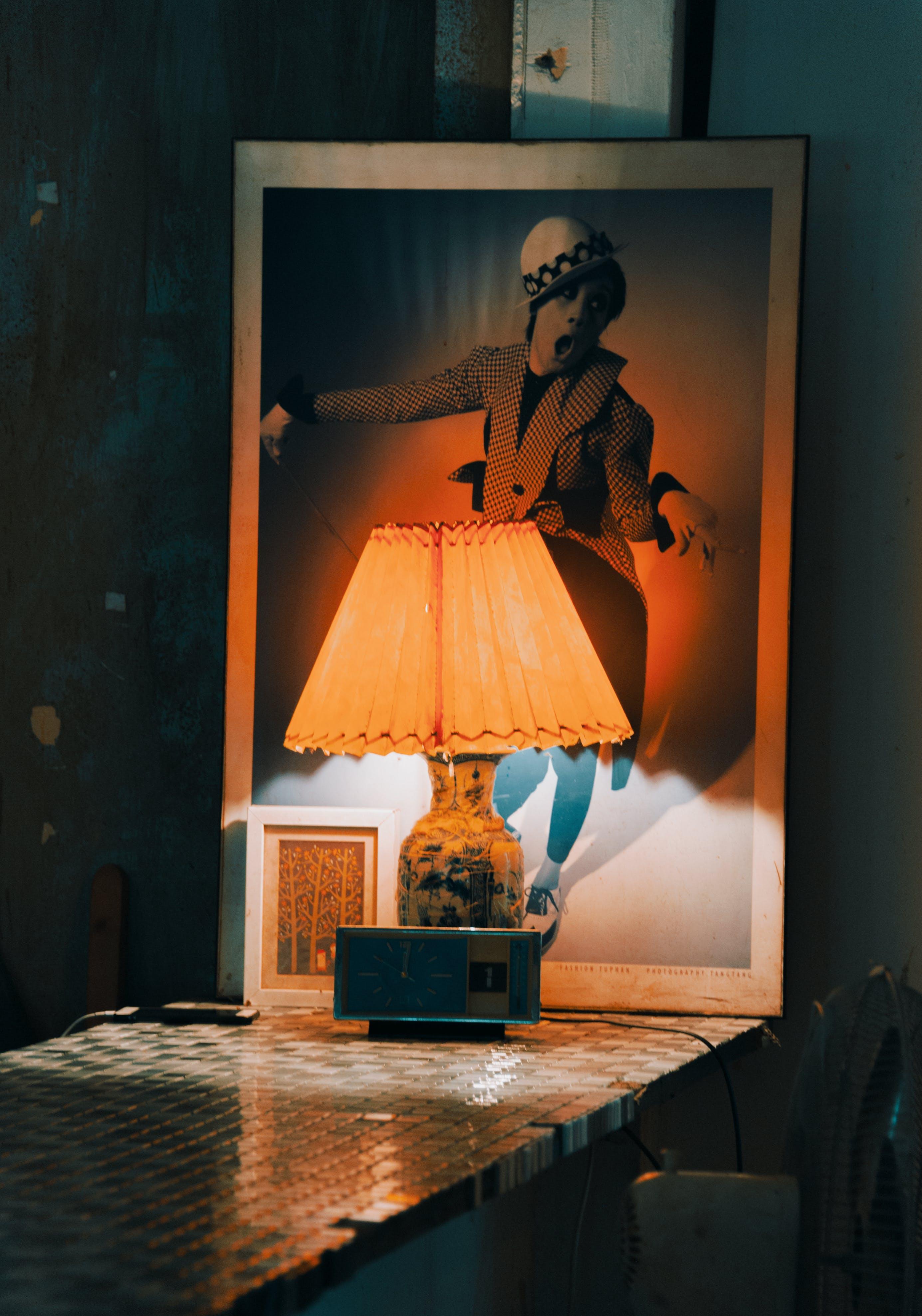 Lamp Near Frame On Table