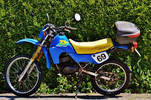 Blue and Yellow Suzuki Ts