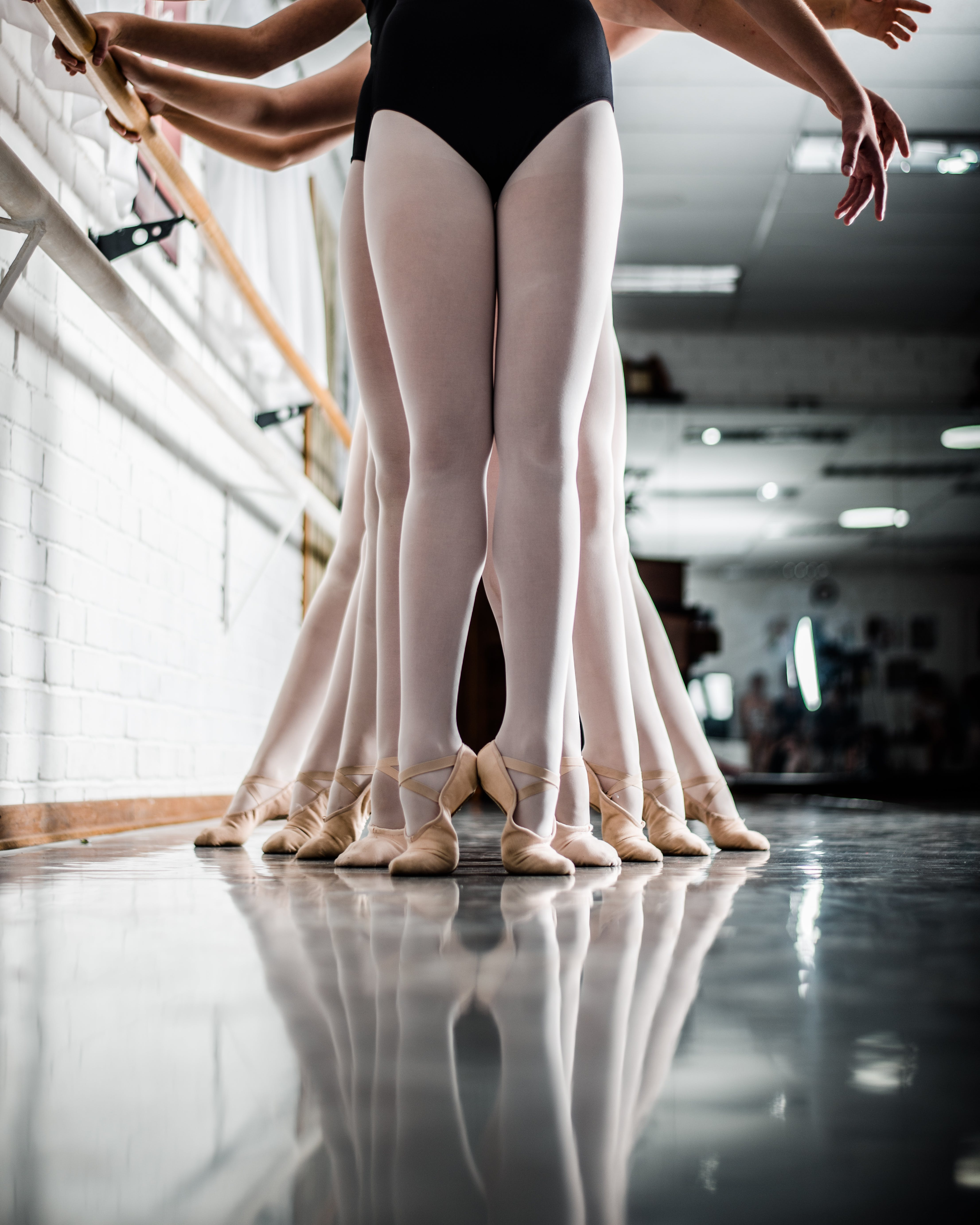 Ballerinas Fall in Line Holding Side Handles