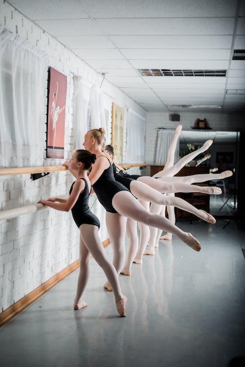 Group Of Girls Doing Ballet Exercise