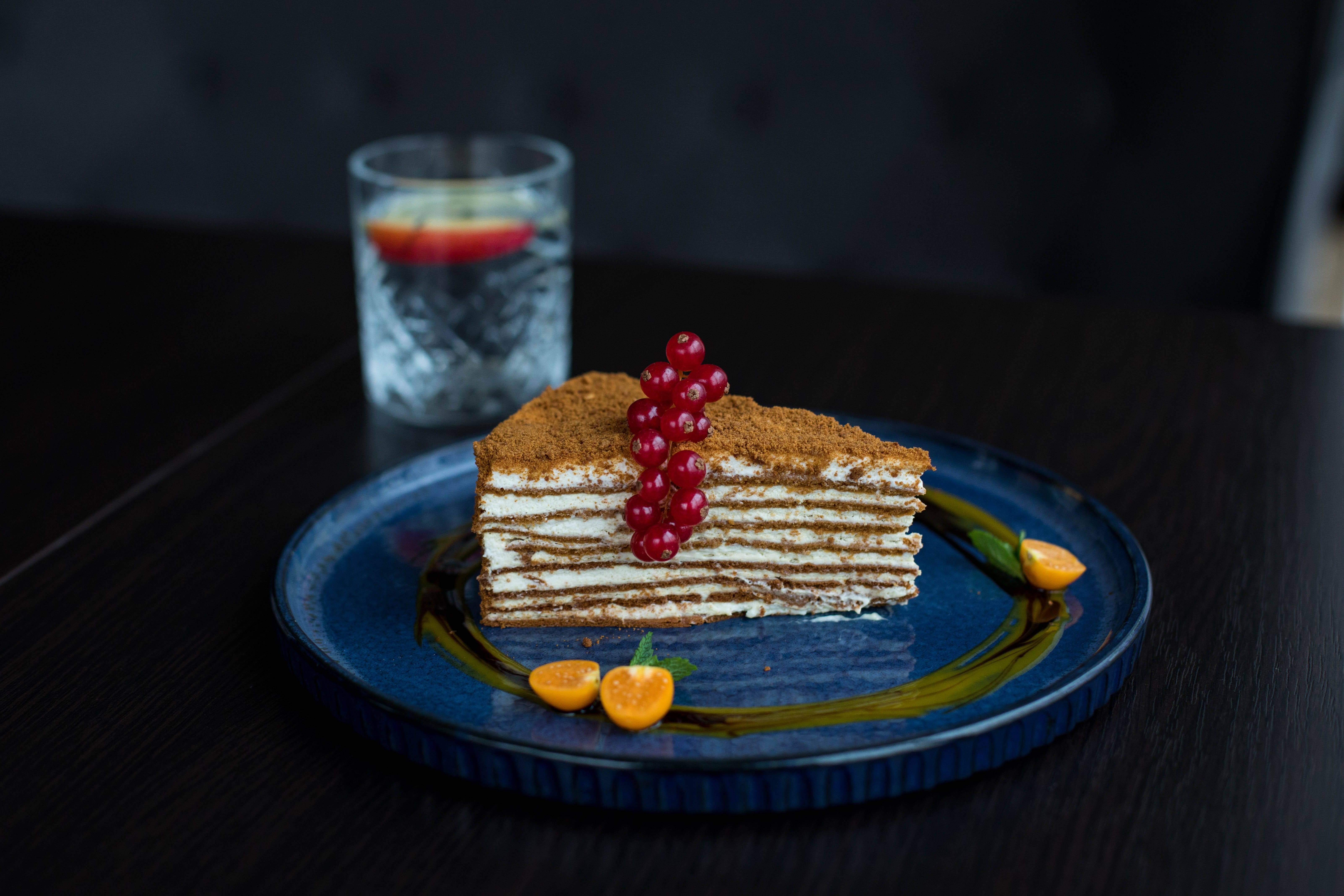 Plate Of Sliced Cake With Berries On Top
