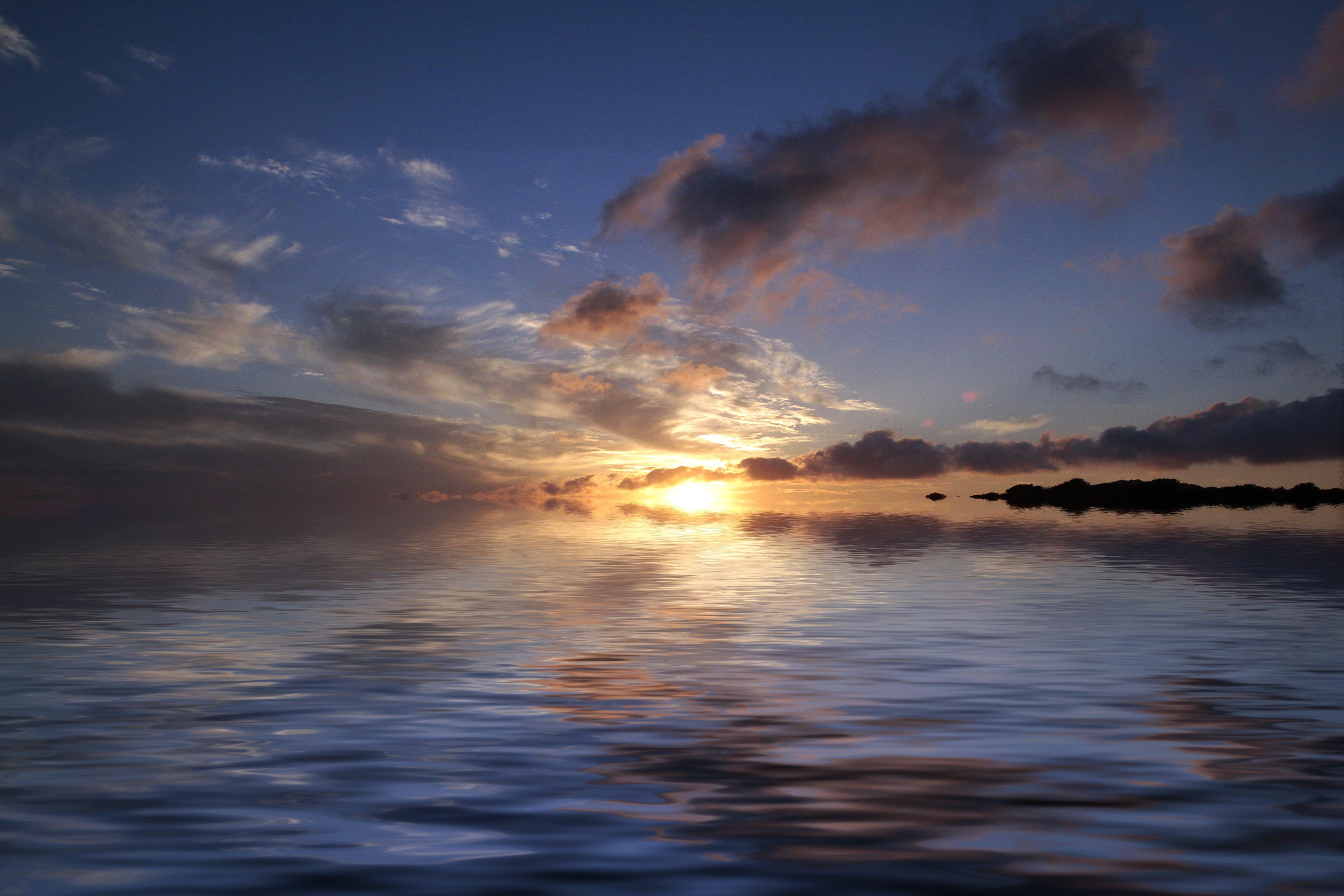Sea Near Island during Sunset