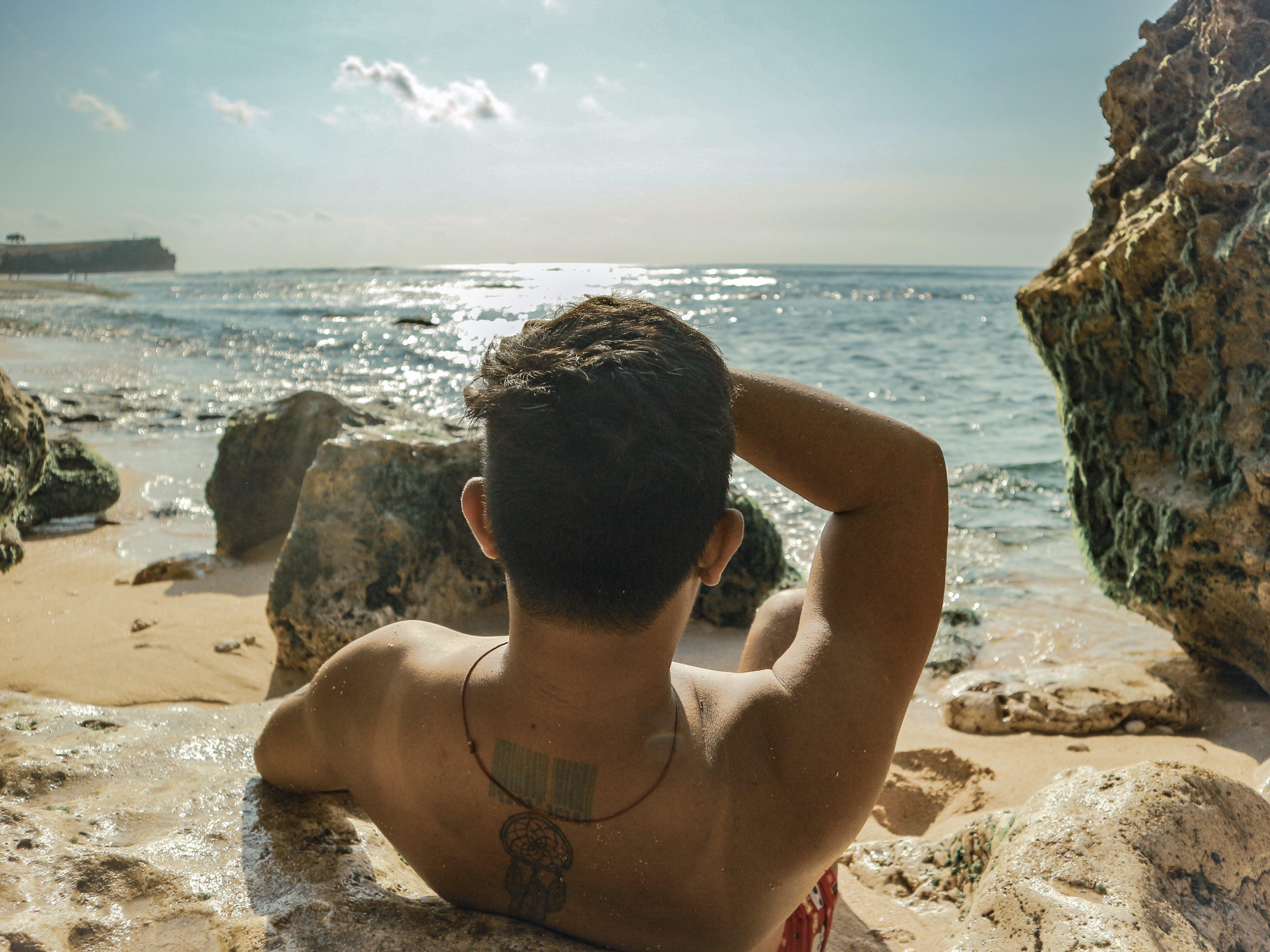 adam, bali, boş zaman, deniz içeren Ücretsiz stok fotoğraf