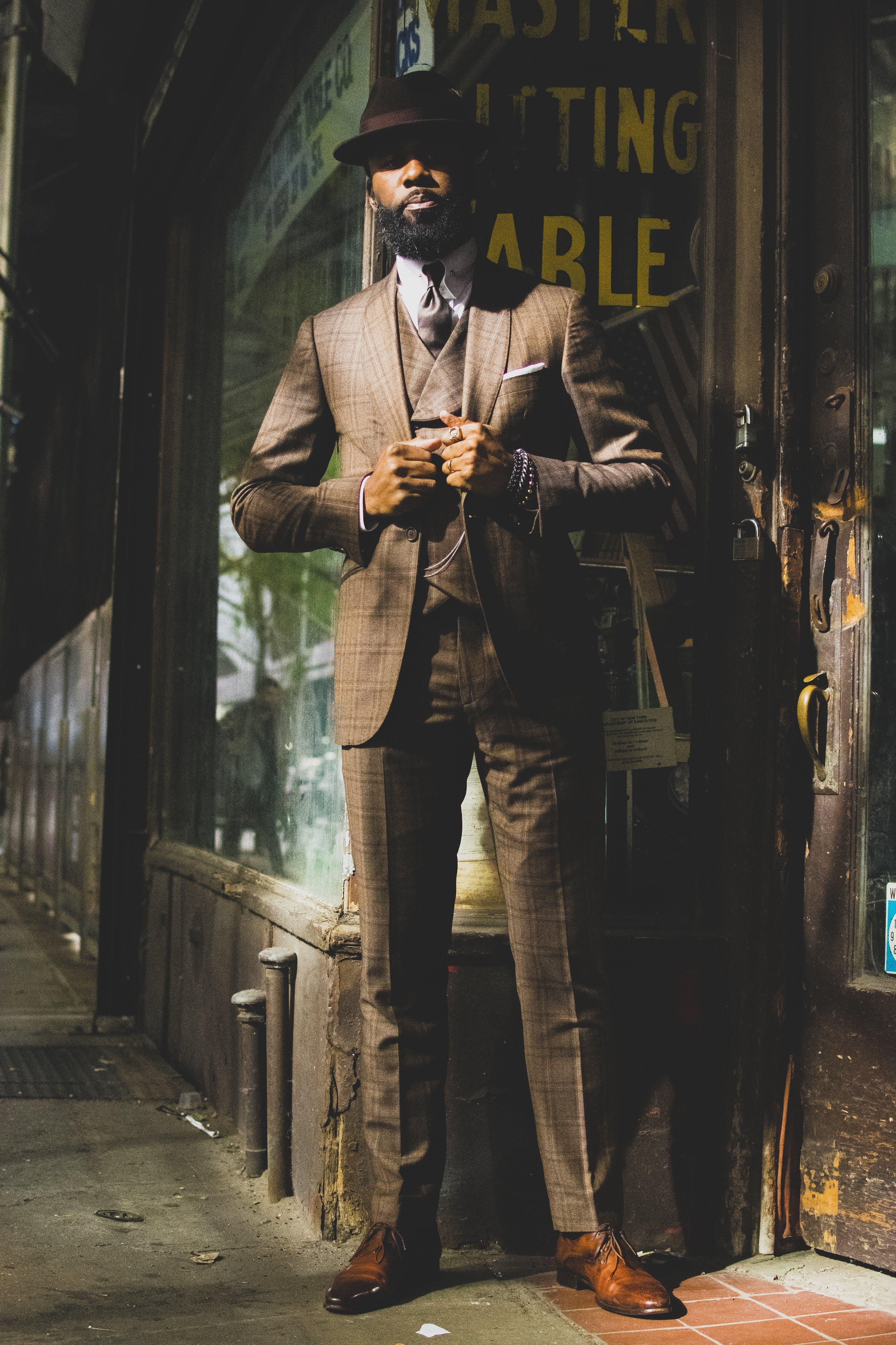 Standing Man in Front of Doorway