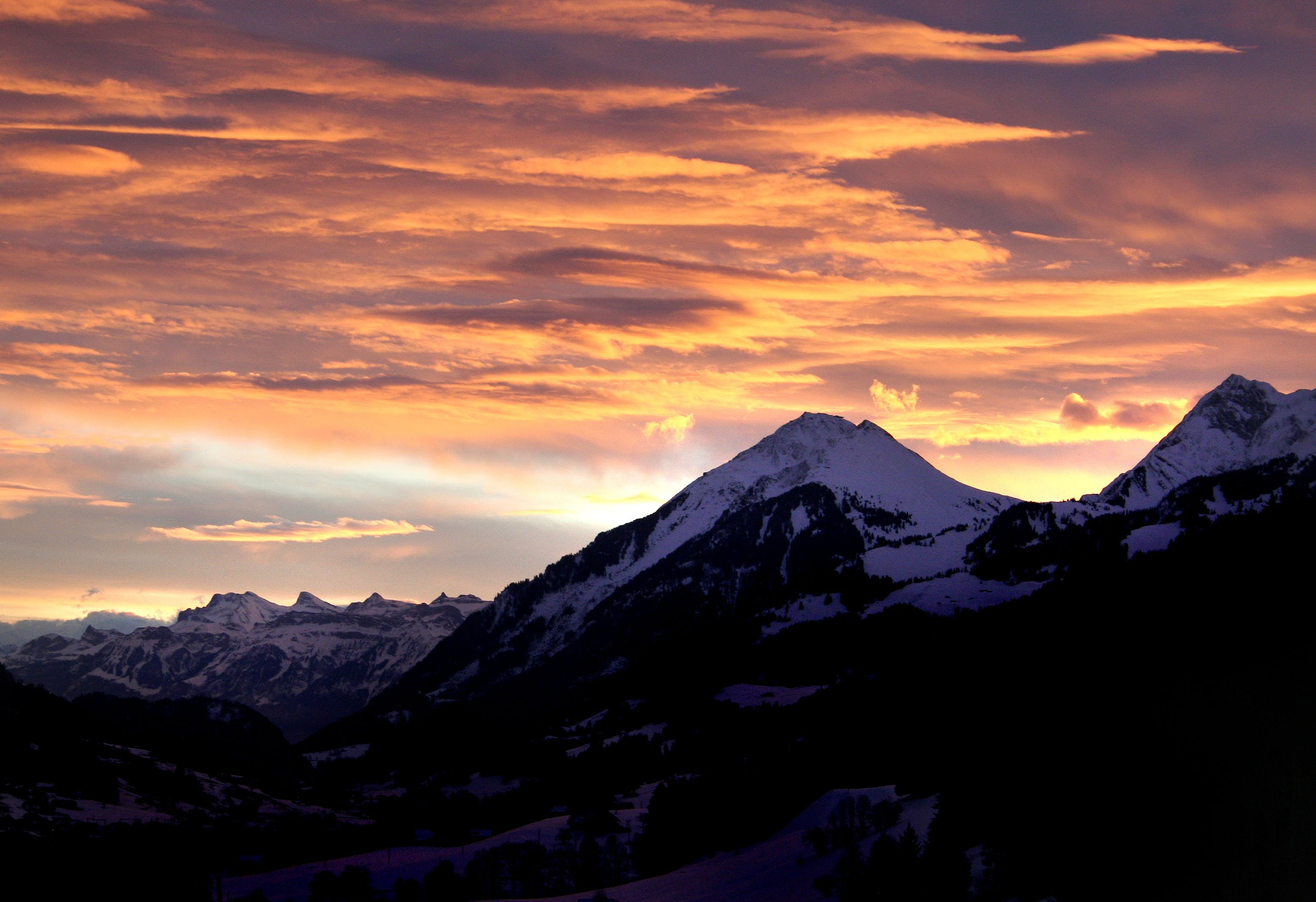 Snow Mountain Under Orange Skies