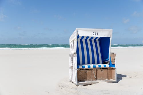 White and Blue Stripe Booth Number 271 on Seashore during Daytime