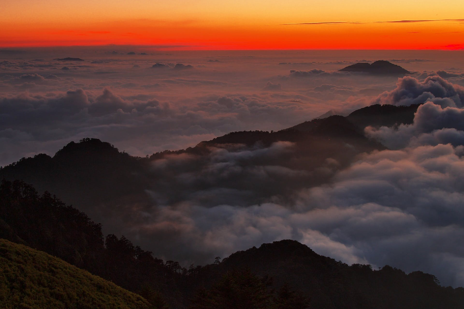 High View Photography of Mountain Ranges Surrounded With Clouds at Golden Hour