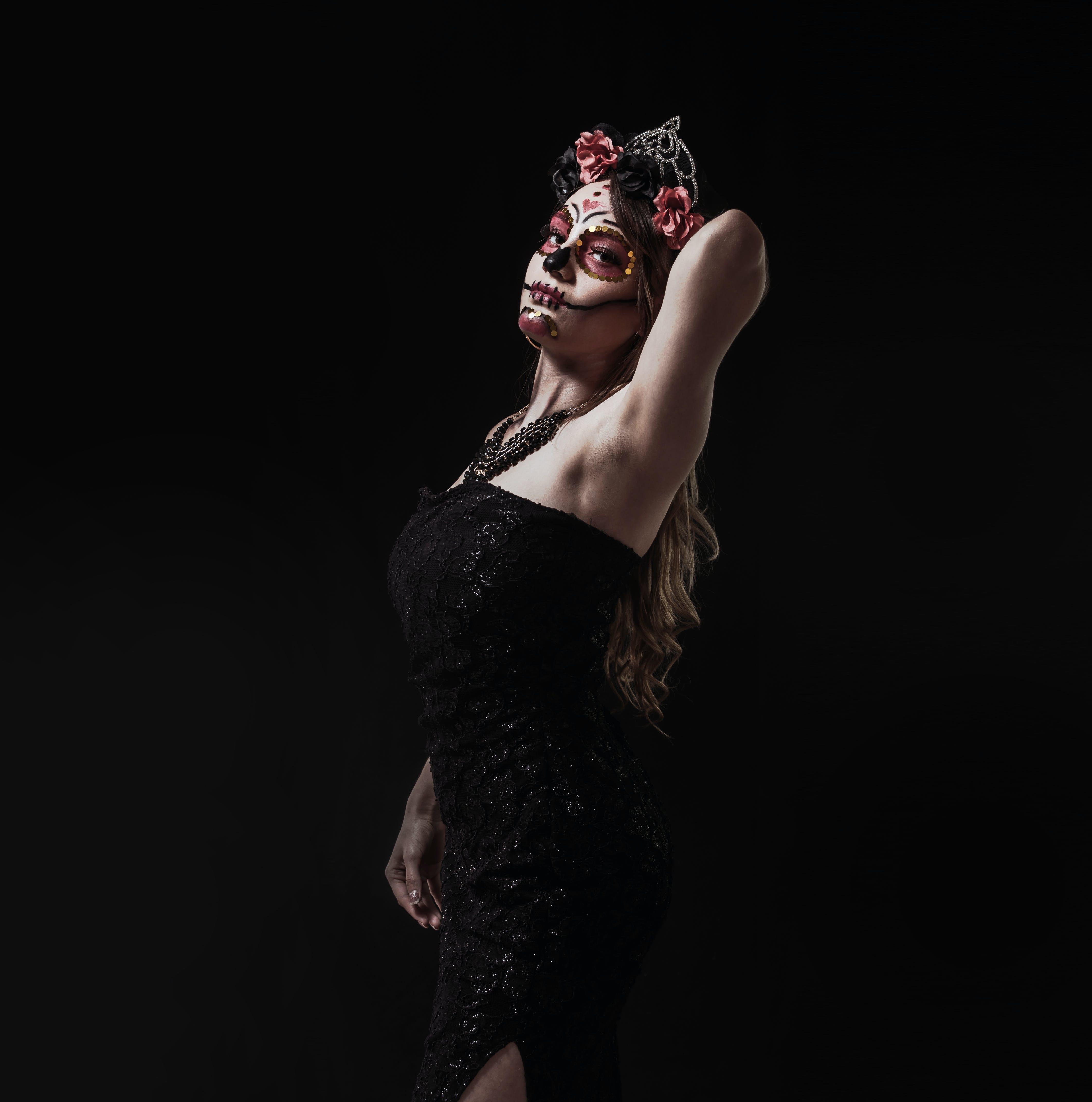 Woman Wearing Black Off-shoulder Dress With Skeletal Makeup