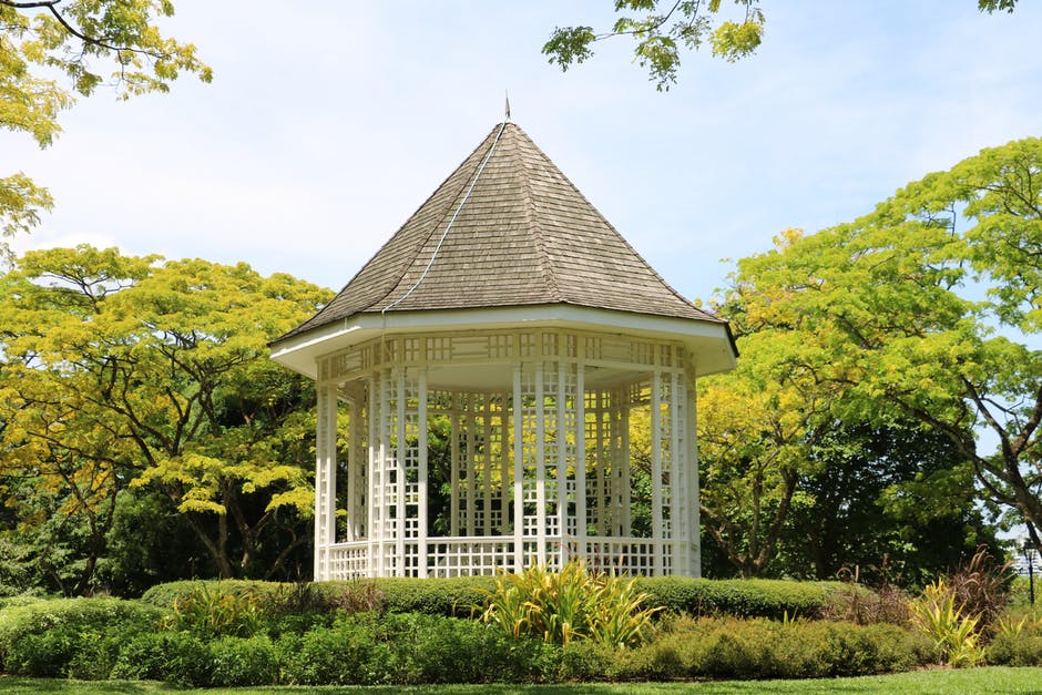 White Wooden Shed in the Middle of the Park during Day Time
