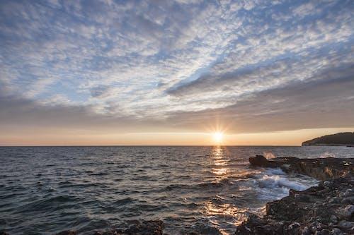 Безкоштовне стокове фото на тему «берег моря, вода, Захід сонця, море»