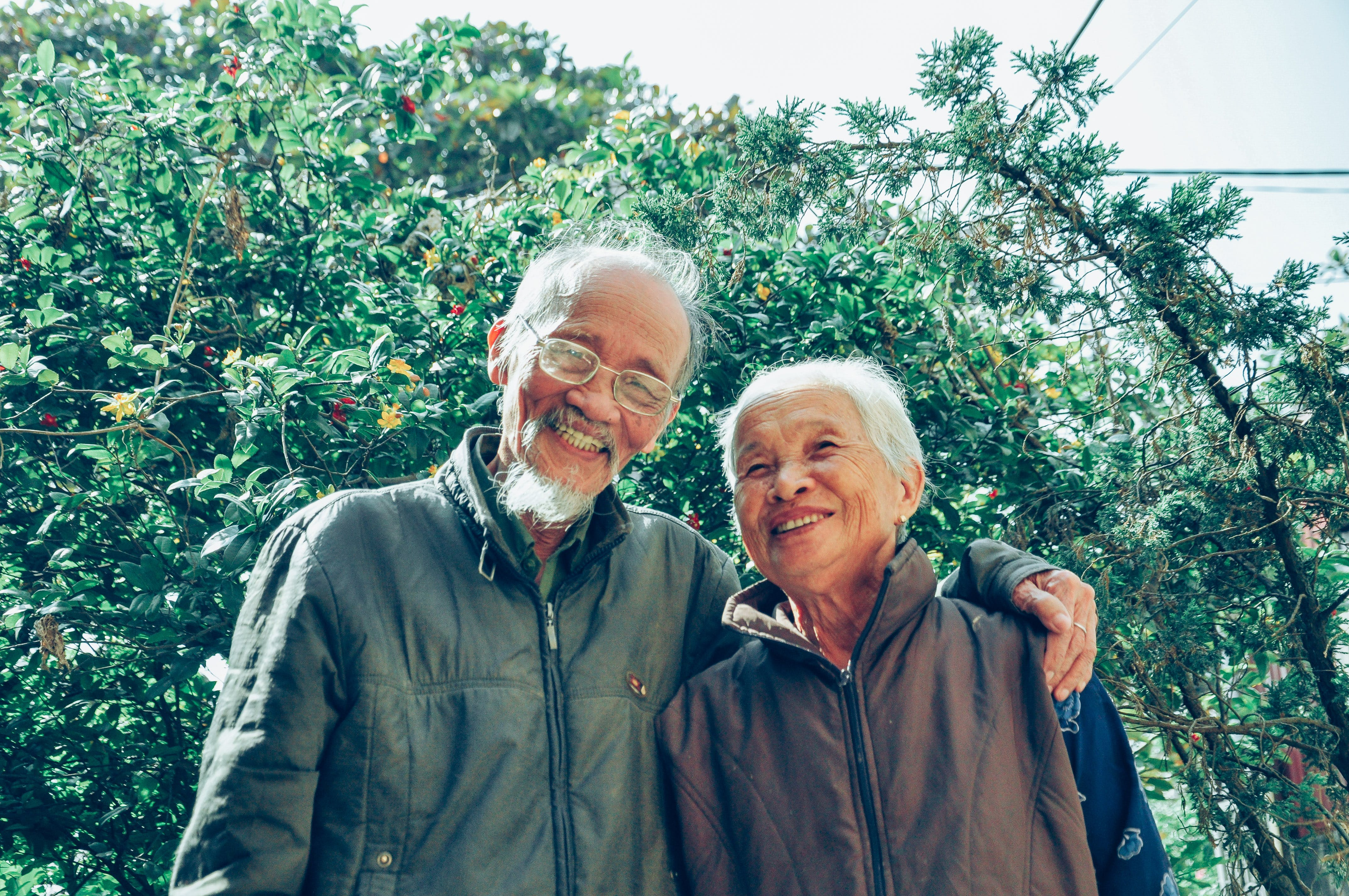 Smiling Man and Woman Wearing Jackets
