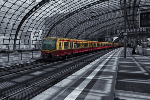 Yellow Train on Railway during Daytime