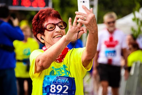 Selective Focus Photography of Woman Taking Selfie
