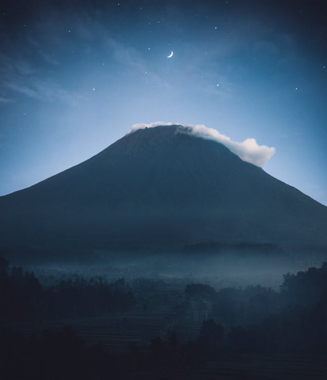 Silhouette of Mountain With Mist on Top