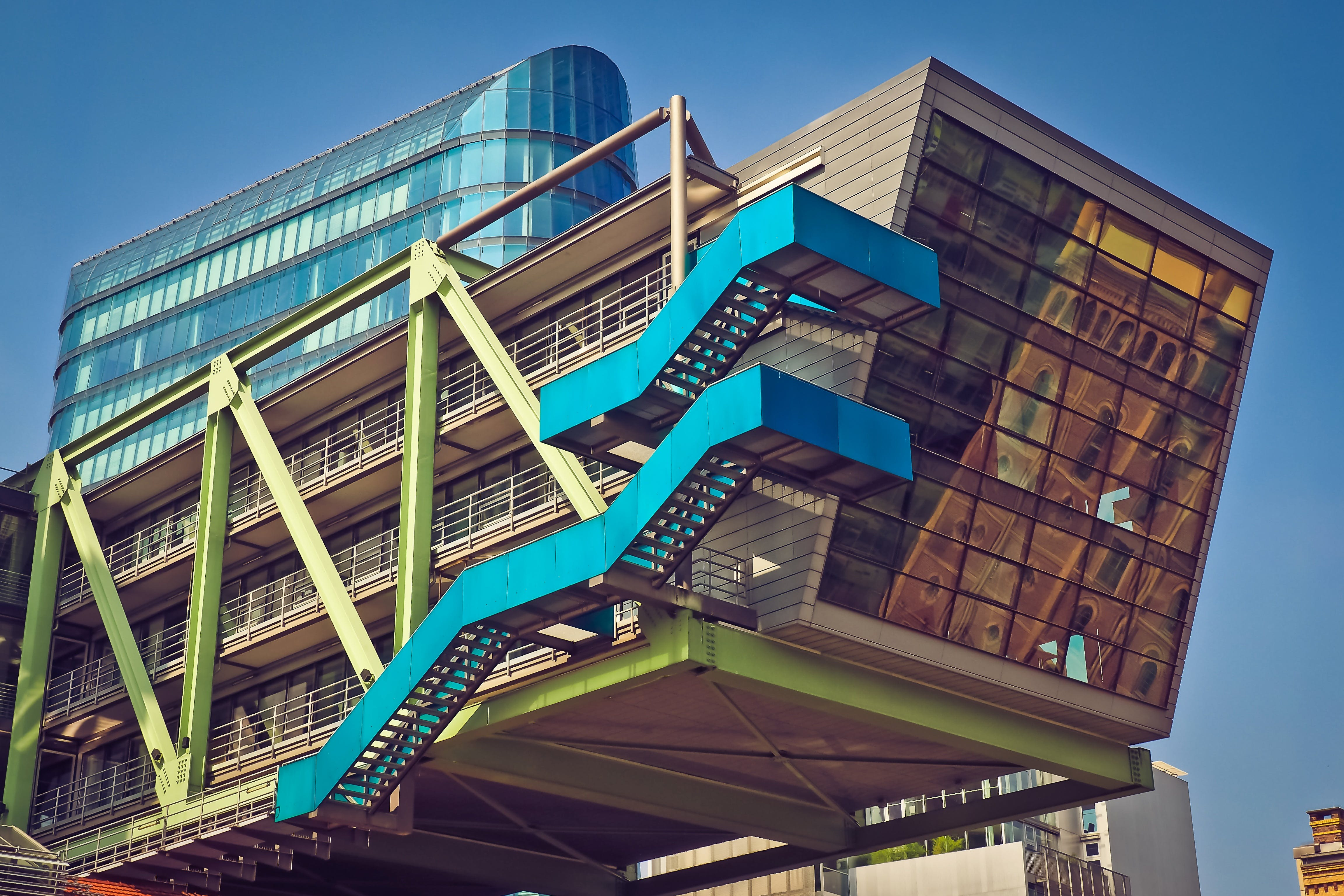 Brown Blue and Green Building With Blue Staircase