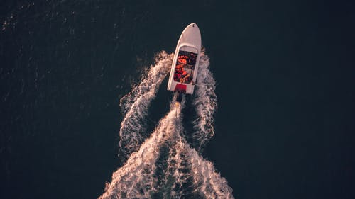 Aerial View of White Motorboat