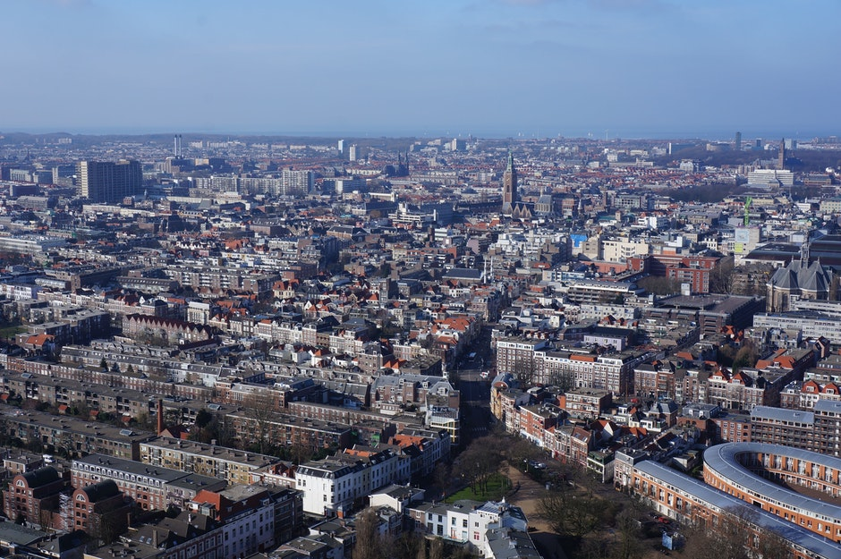 Aerial View of the City Under Blue and White Cloudy Sky