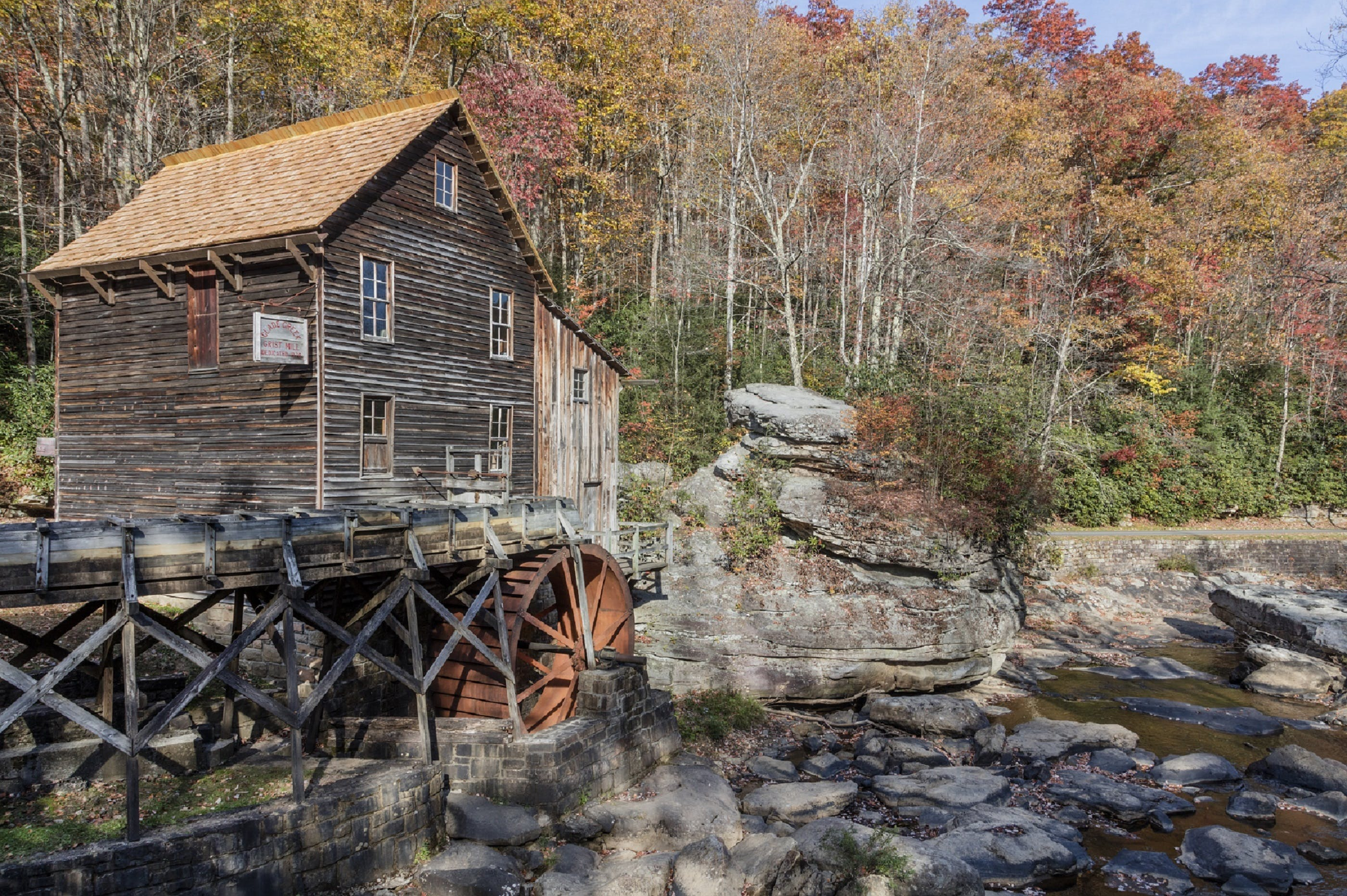 Brown Cabin Under Water Wheel