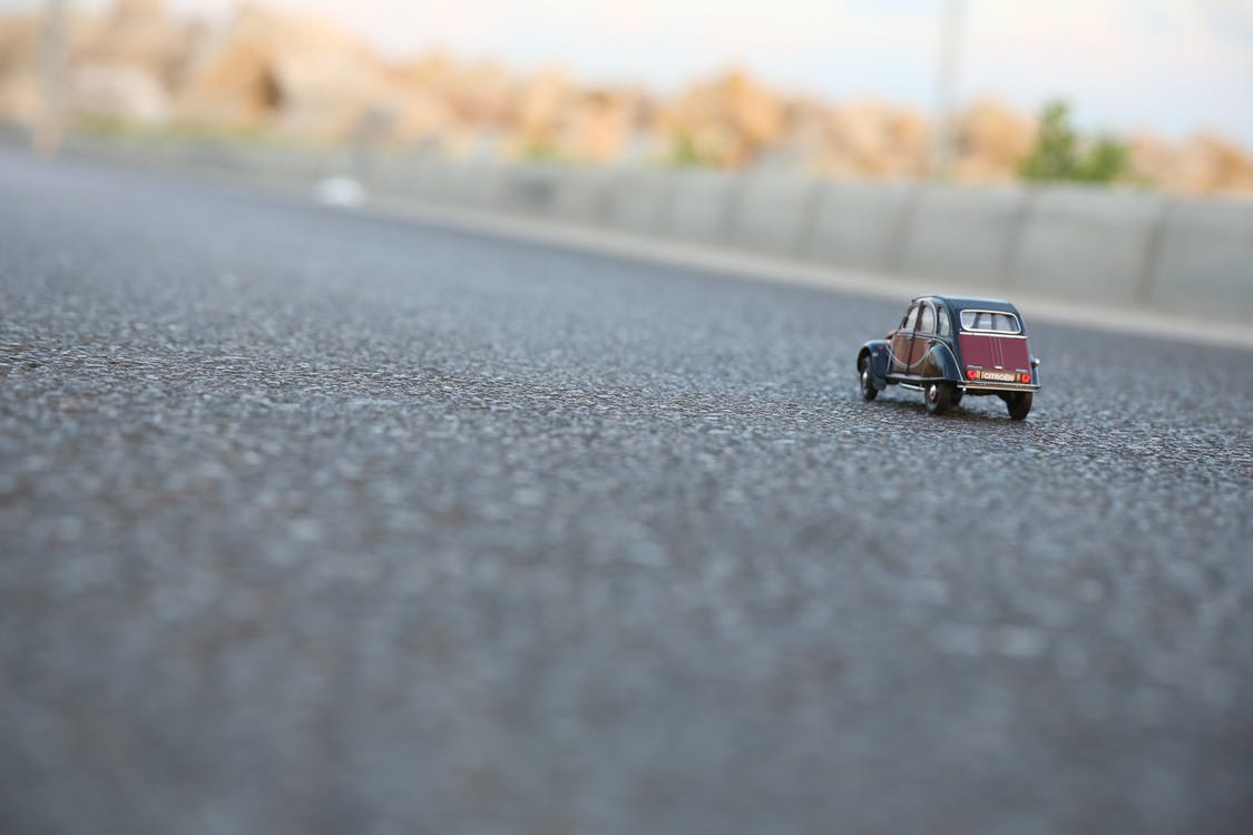 Red and Black Car Die-cast Model on Ground