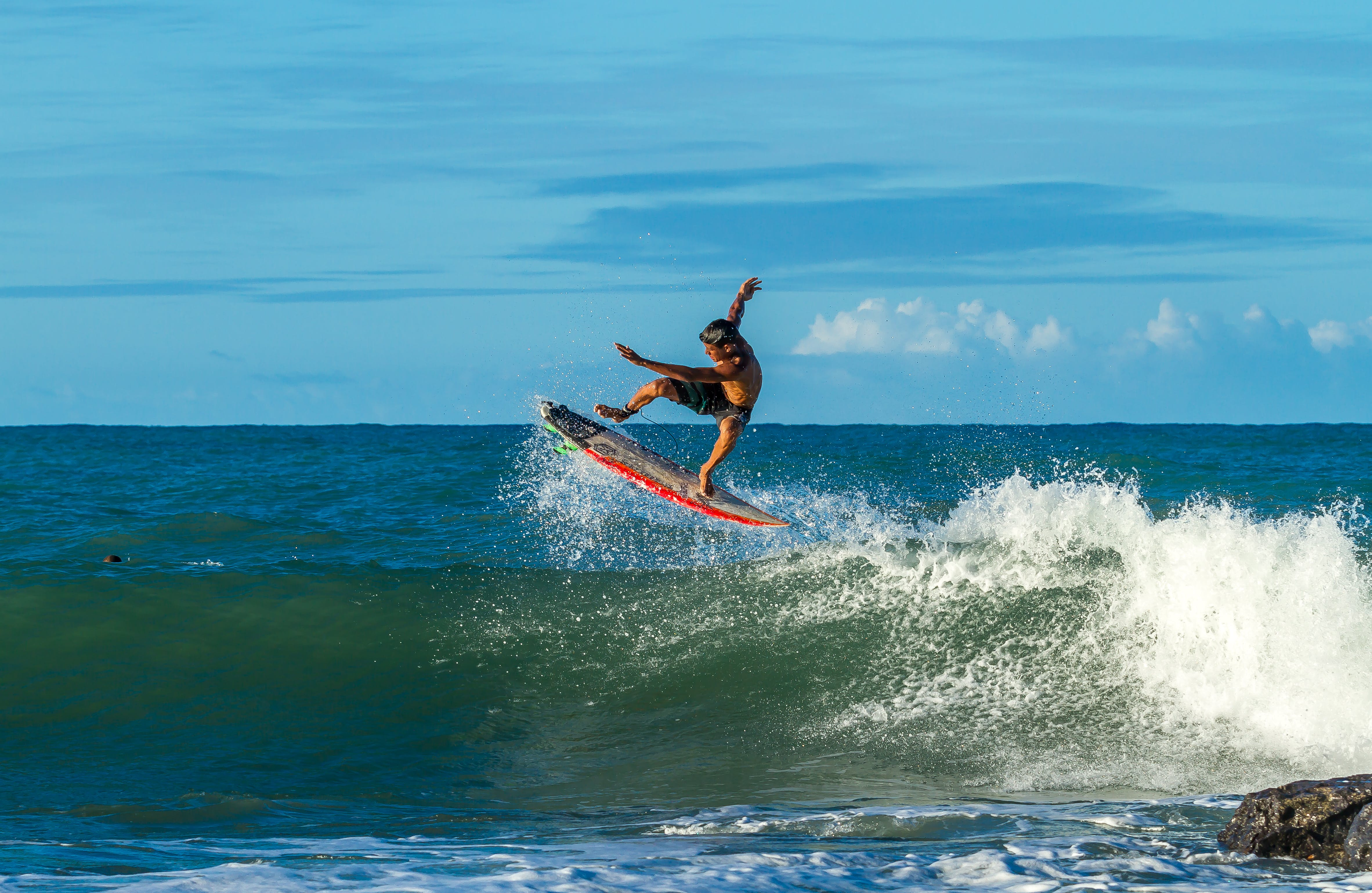Man Surfing during Day