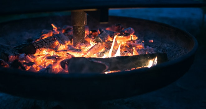 Round Fire Pit With Burning Wood