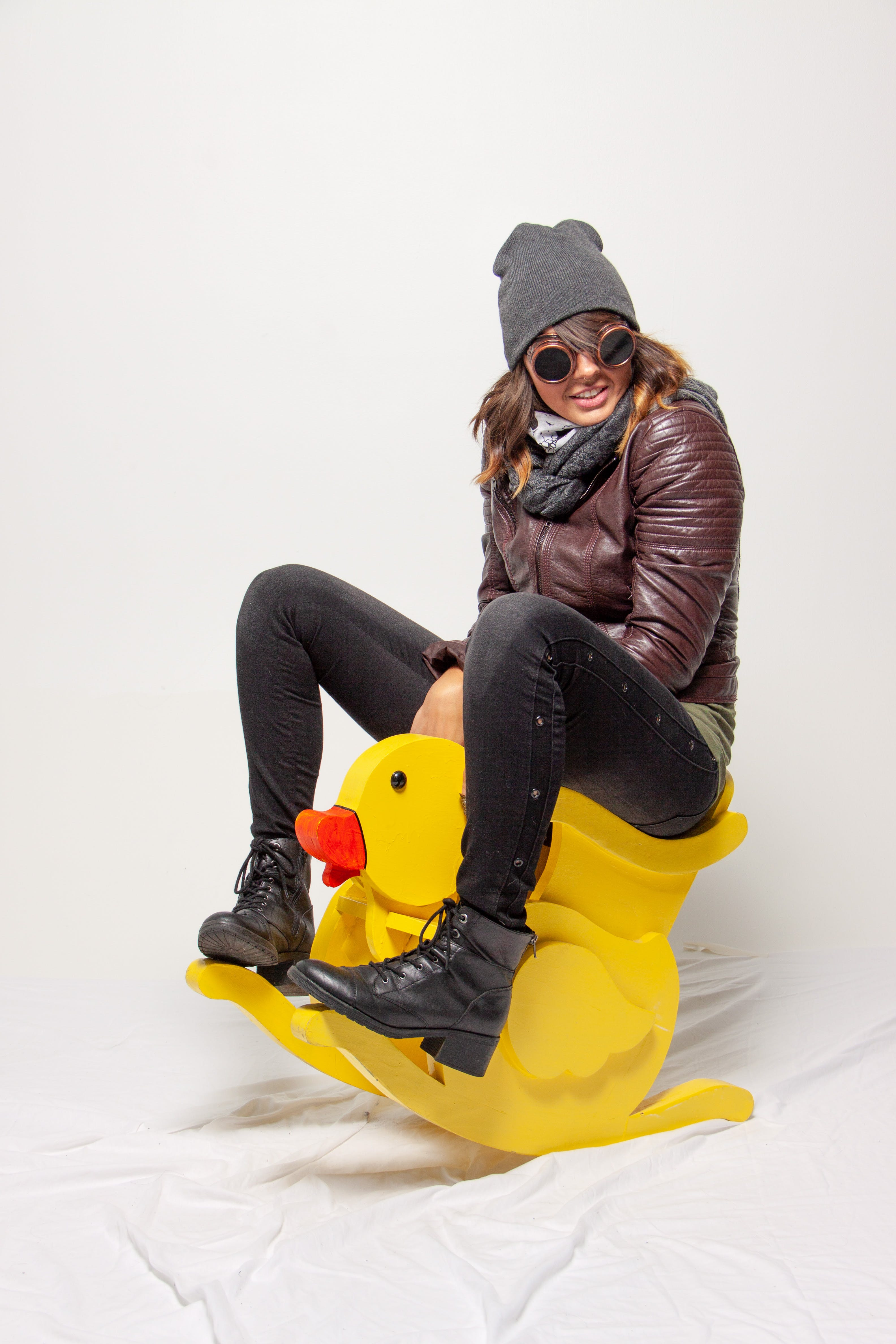 Woman Riding On Yellow Ride On Toy