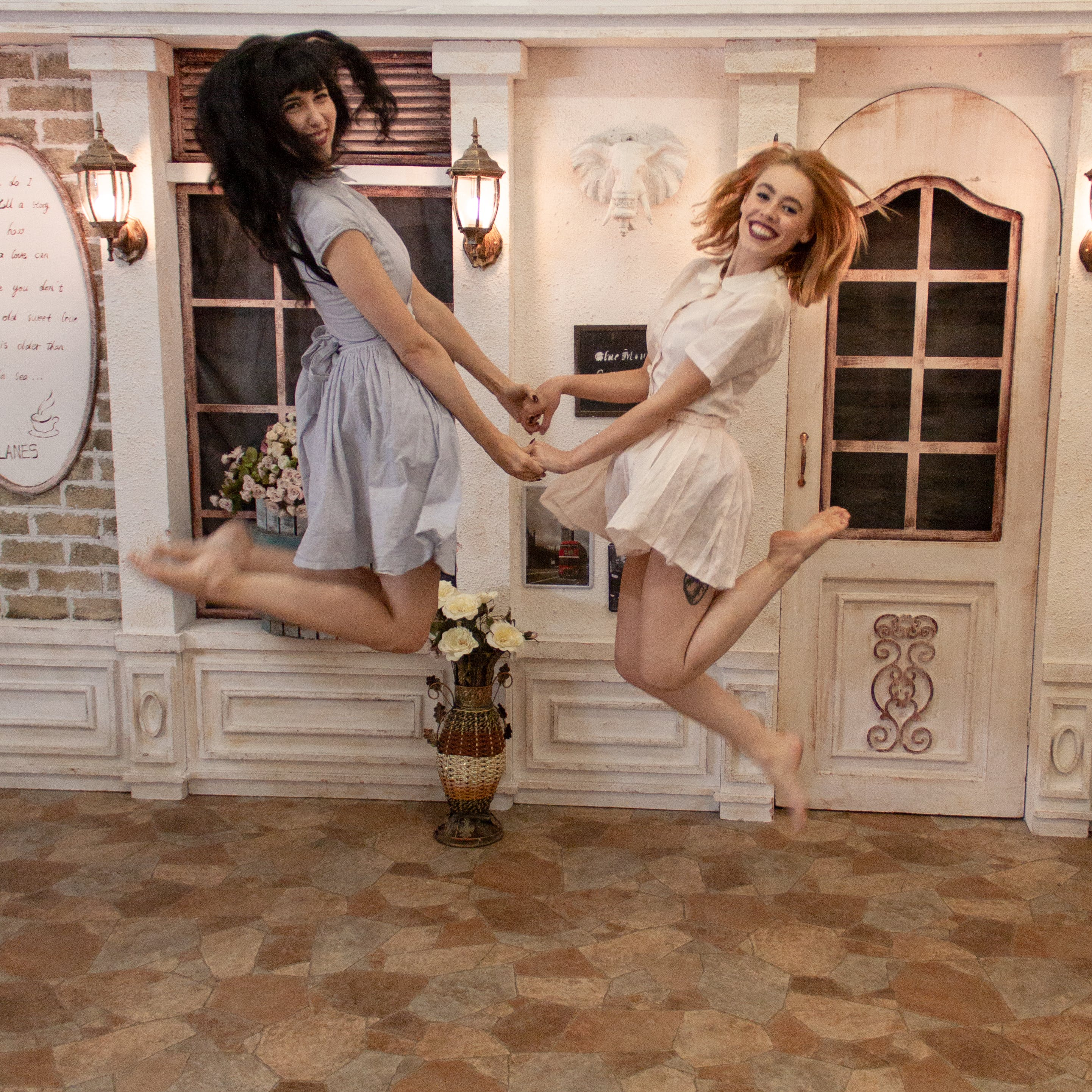 Photo of Two Women Jumping