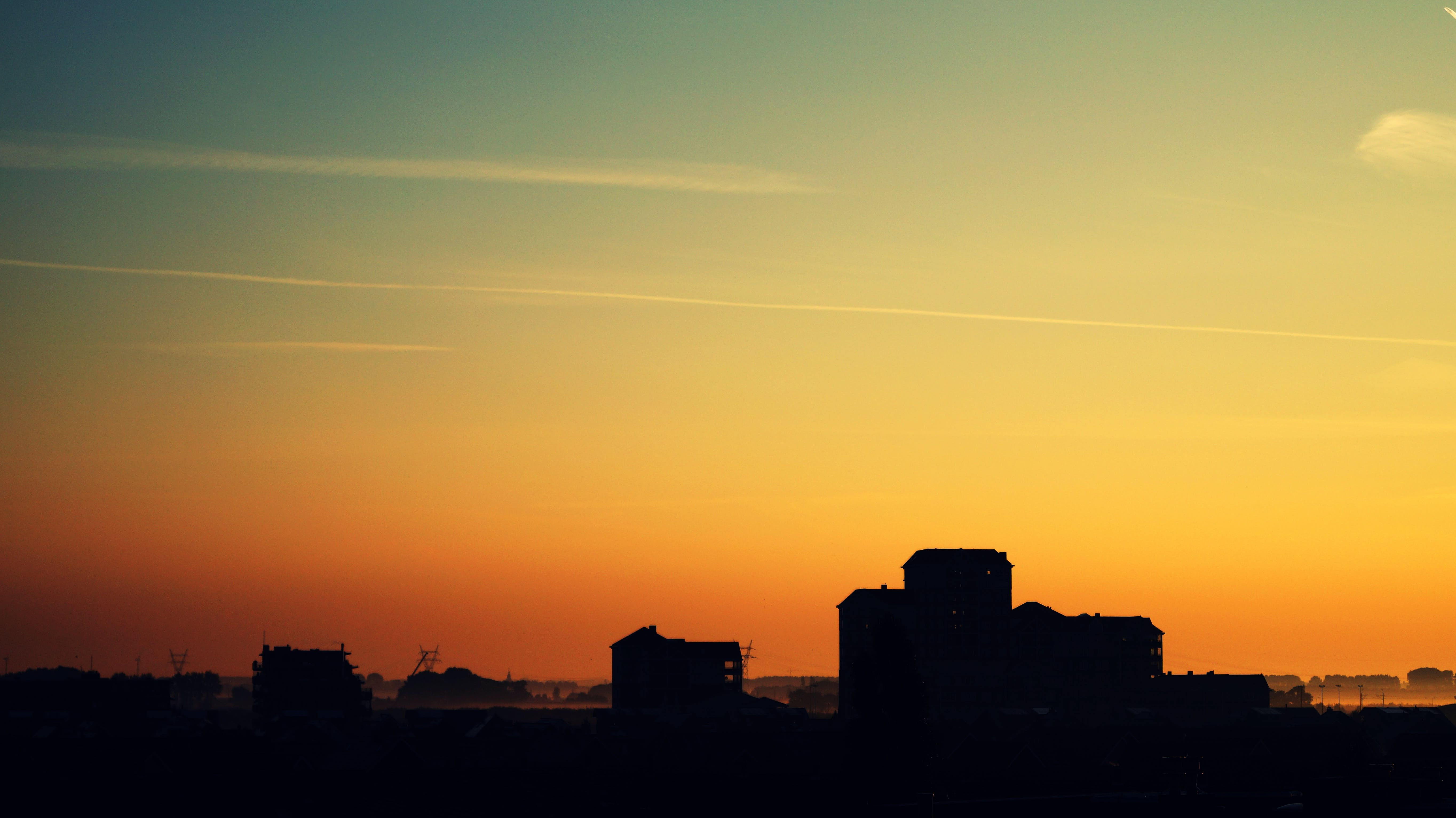 Silhouette of High Rise Building Under Golden Sun