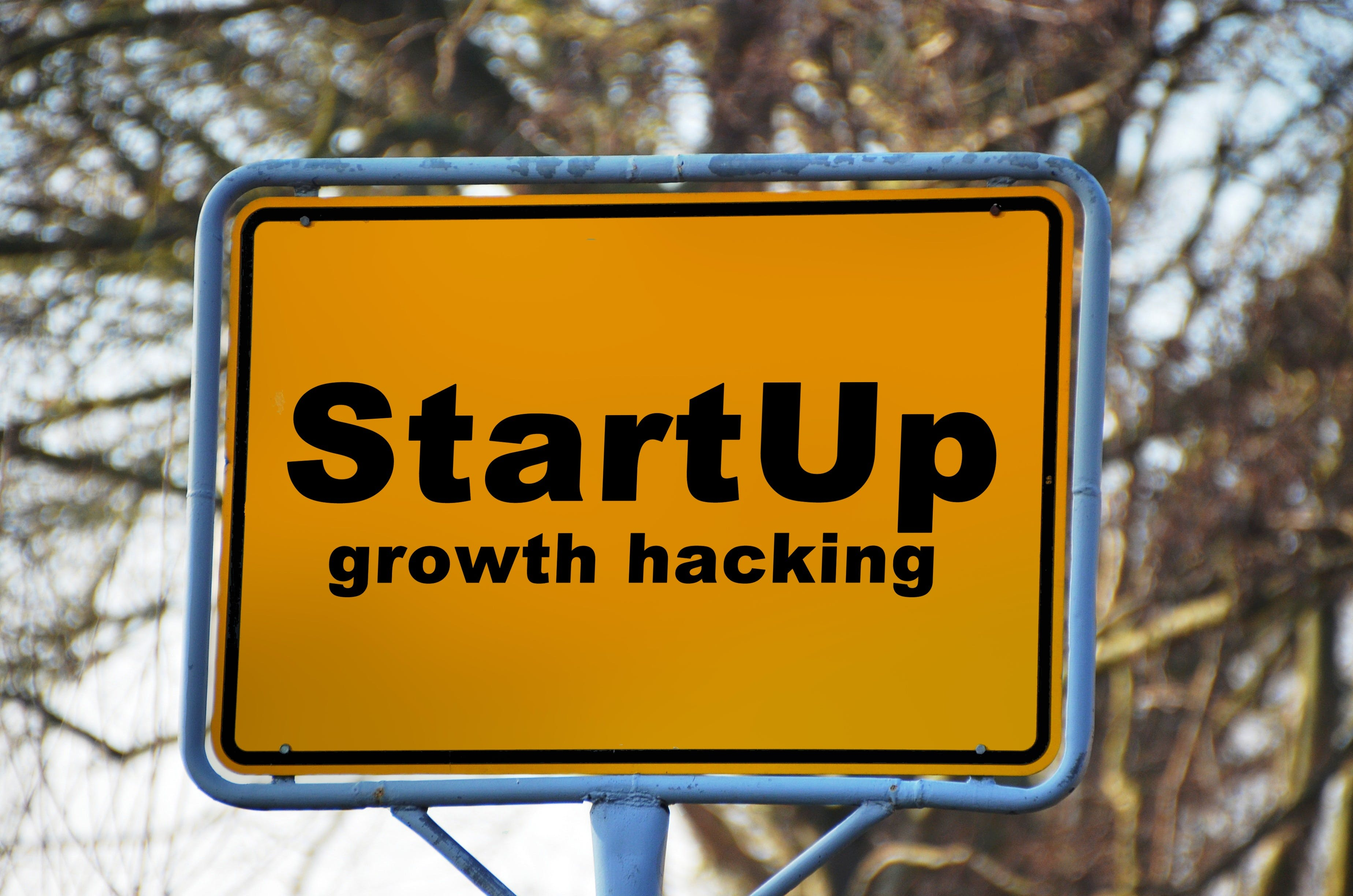 Yellow and Black Start Up Growth Hacking Signage