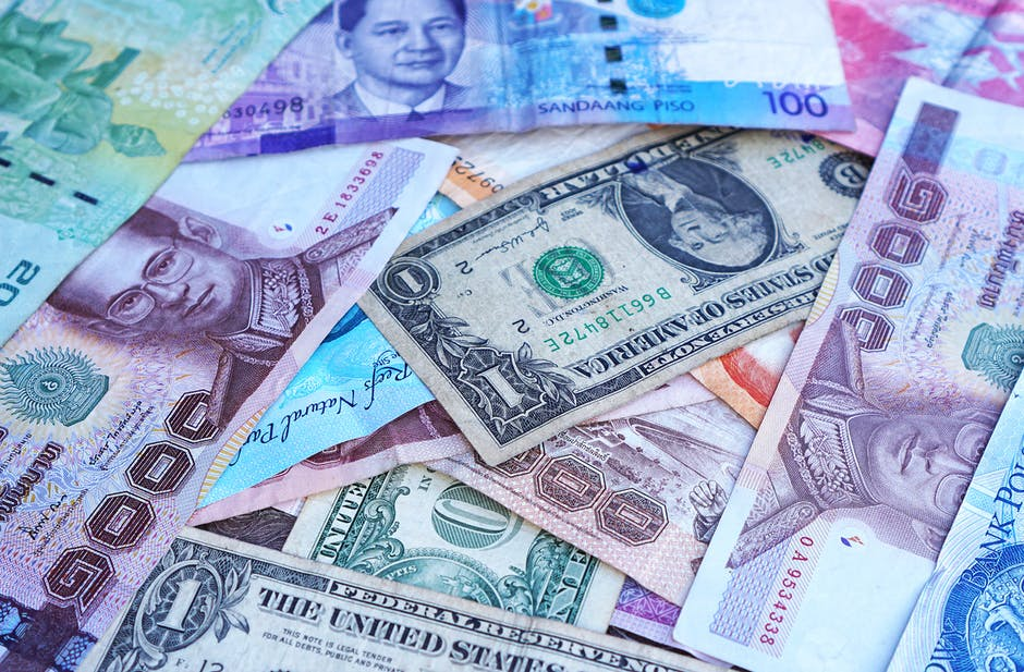 One U.s. Dollar Beside 100 Philippine Pesos