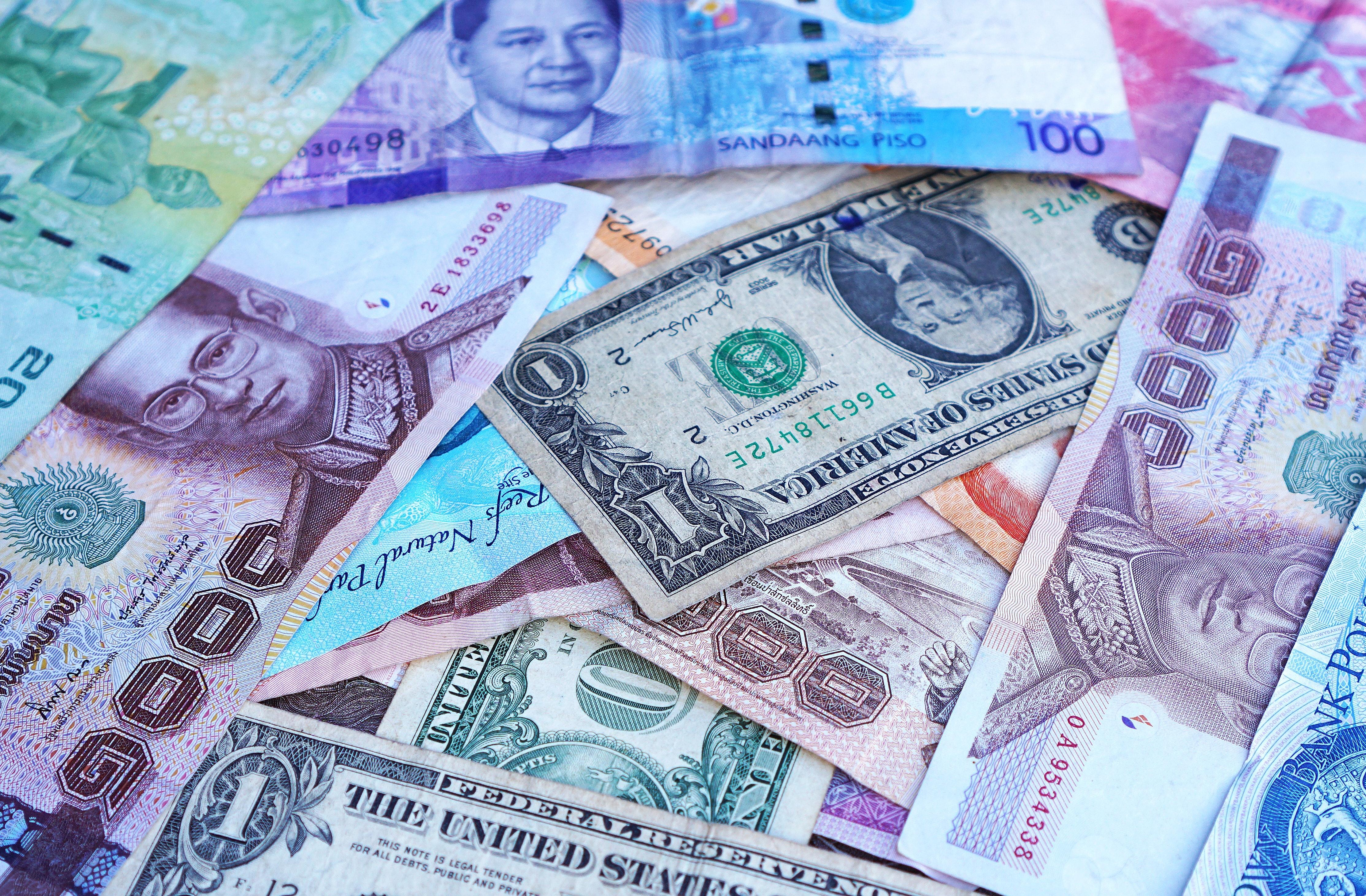 One U S Dollar Beside 100 Philippine Pesos