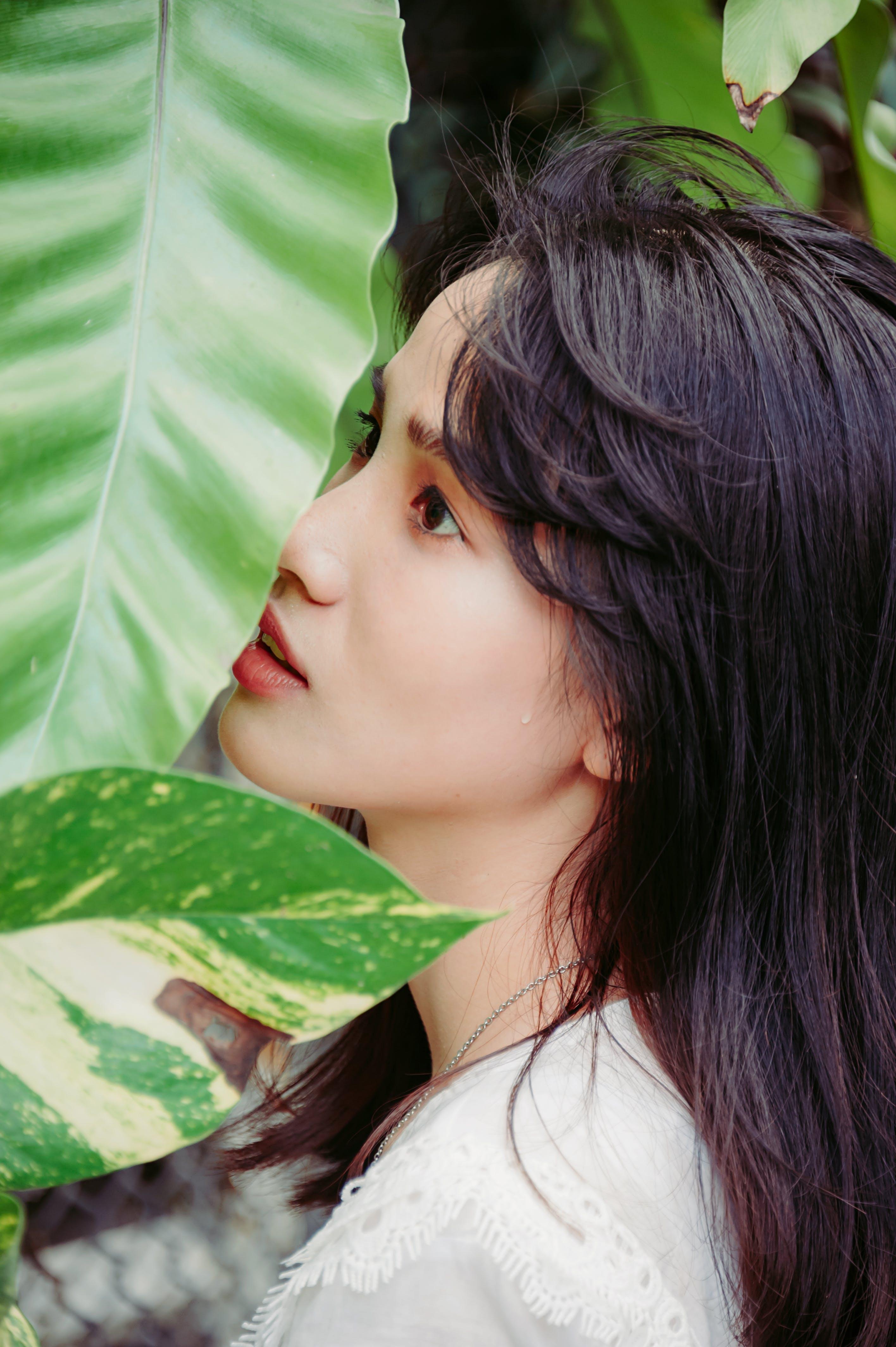 Woman's Face Near Leaf