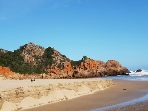 Δωρεάν στοκ φωτογραφιών με ακτής του ωκεανού, άμμος, βουνά, βράχια