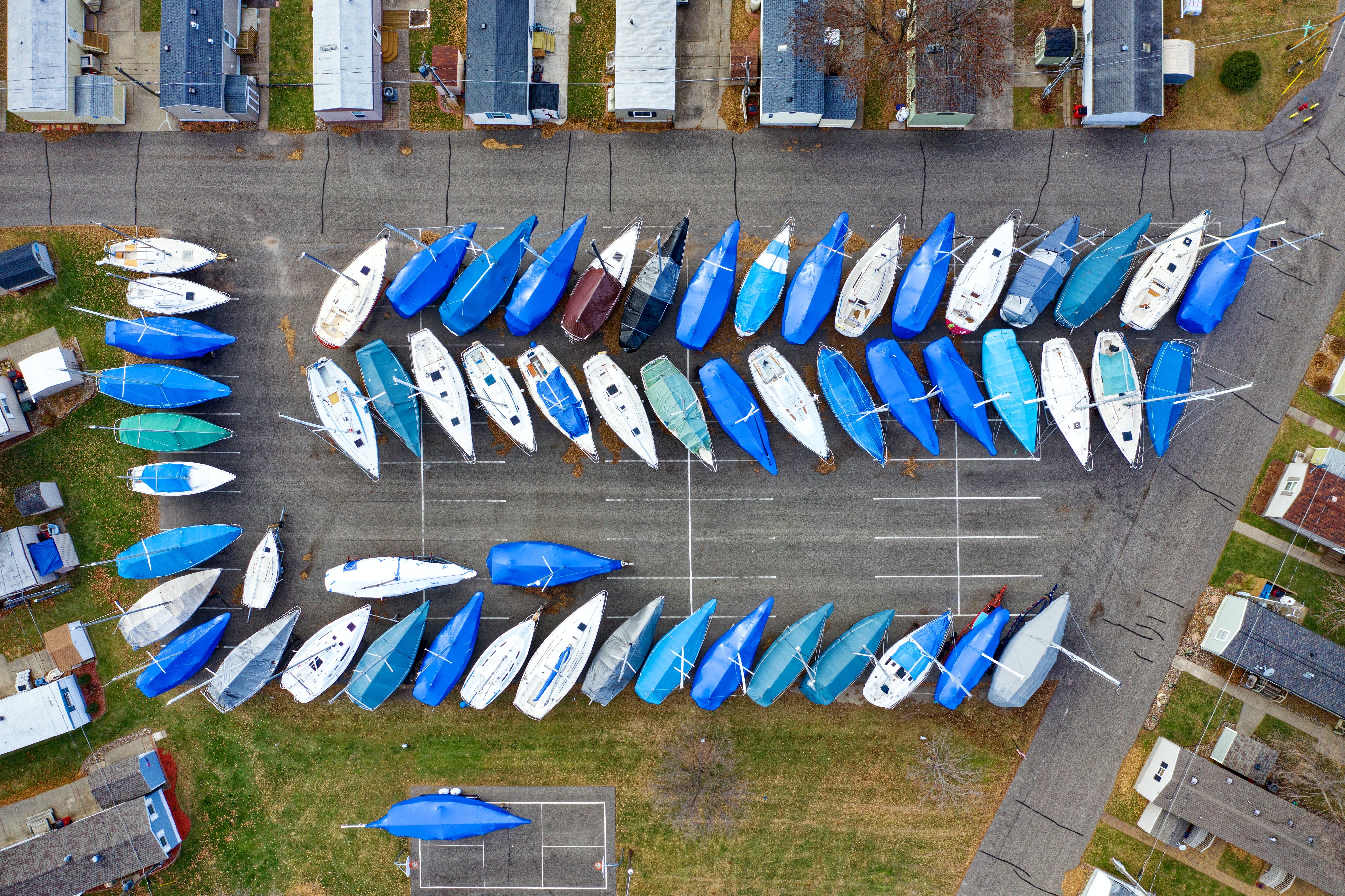 Parked Blue and White Kayaks