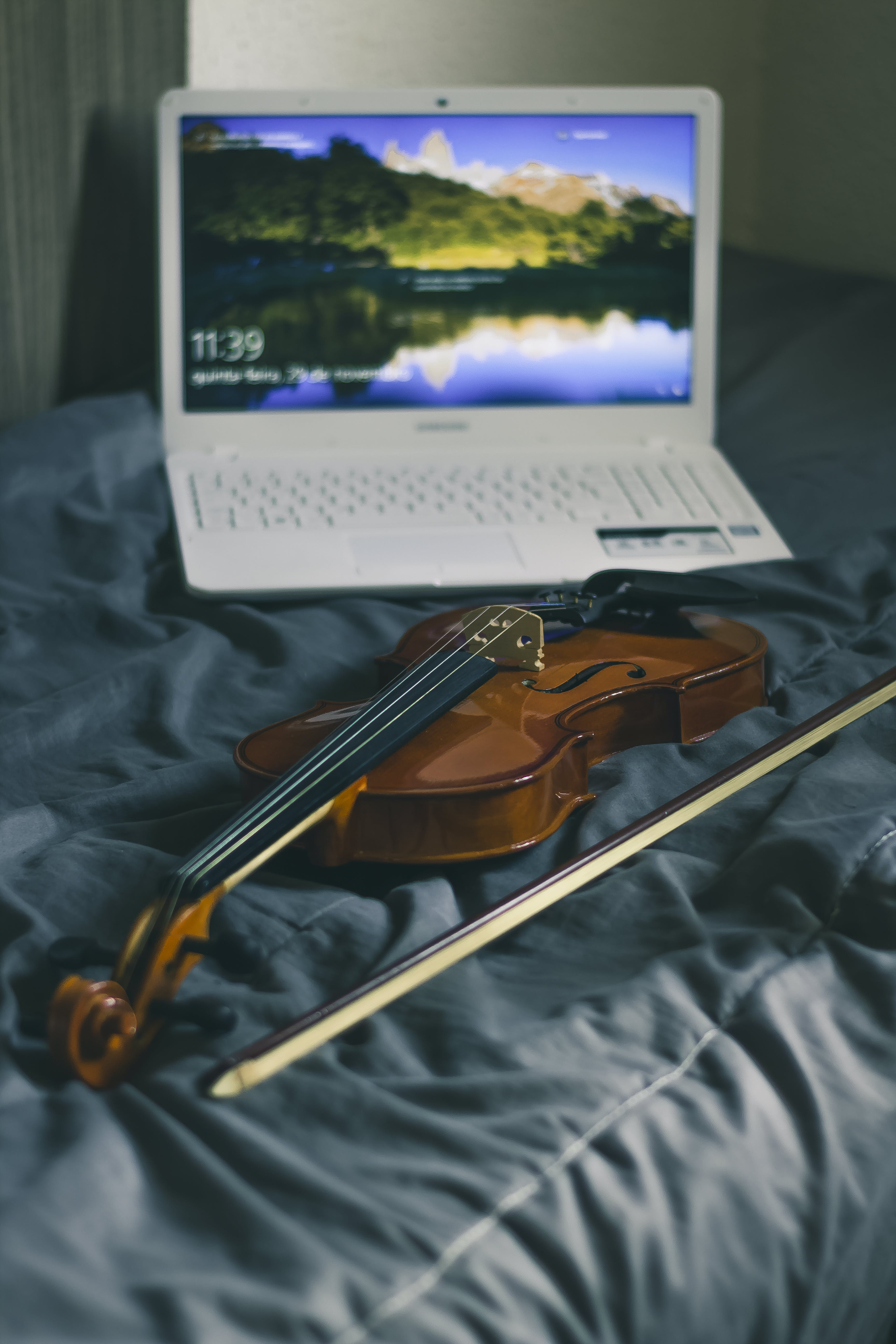 Photograph of White Laptop and Violin