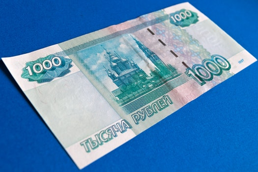 1000 Banknote on Top of Blue Surface
