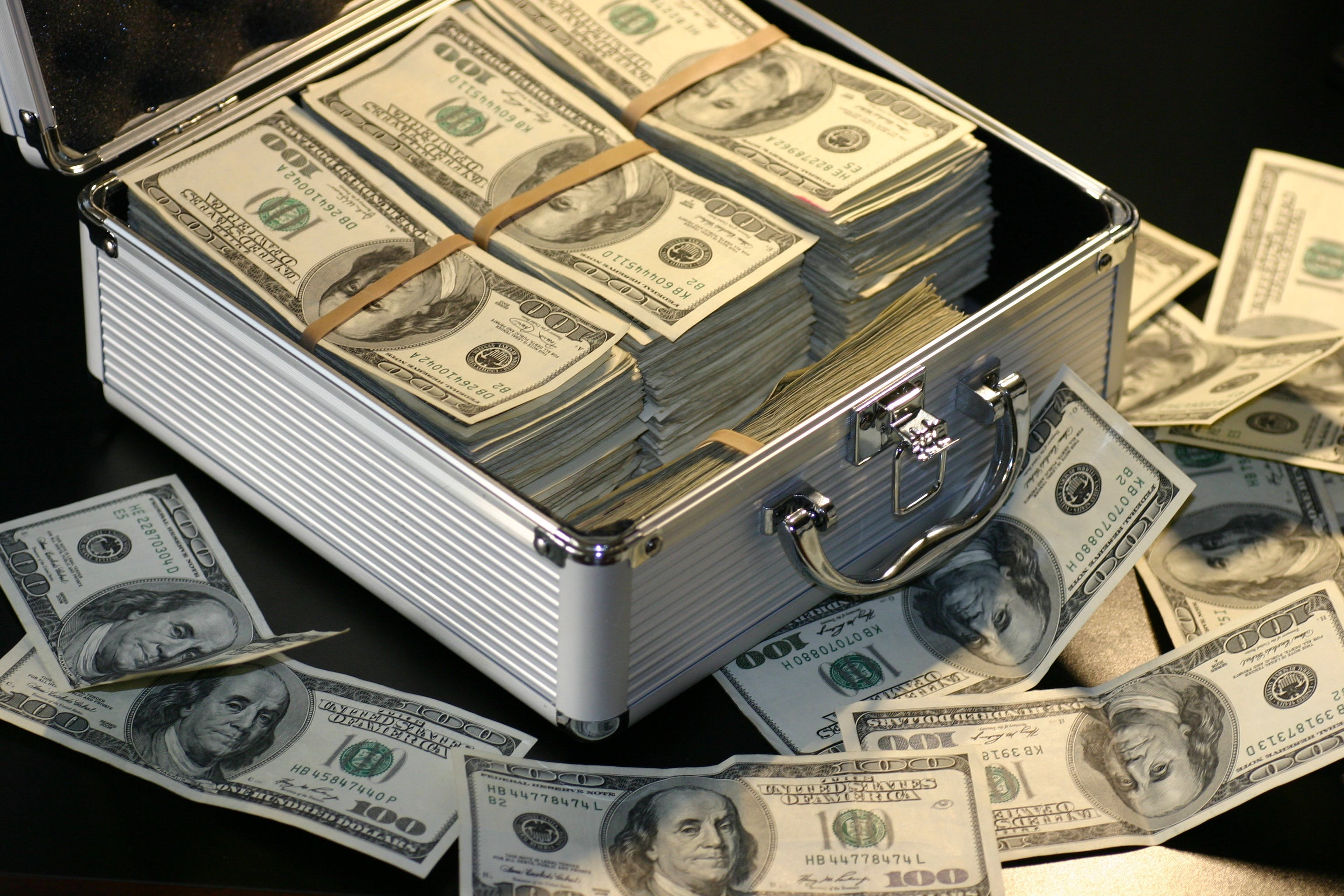 Grey Metal Case of Hundred Dollar Bills