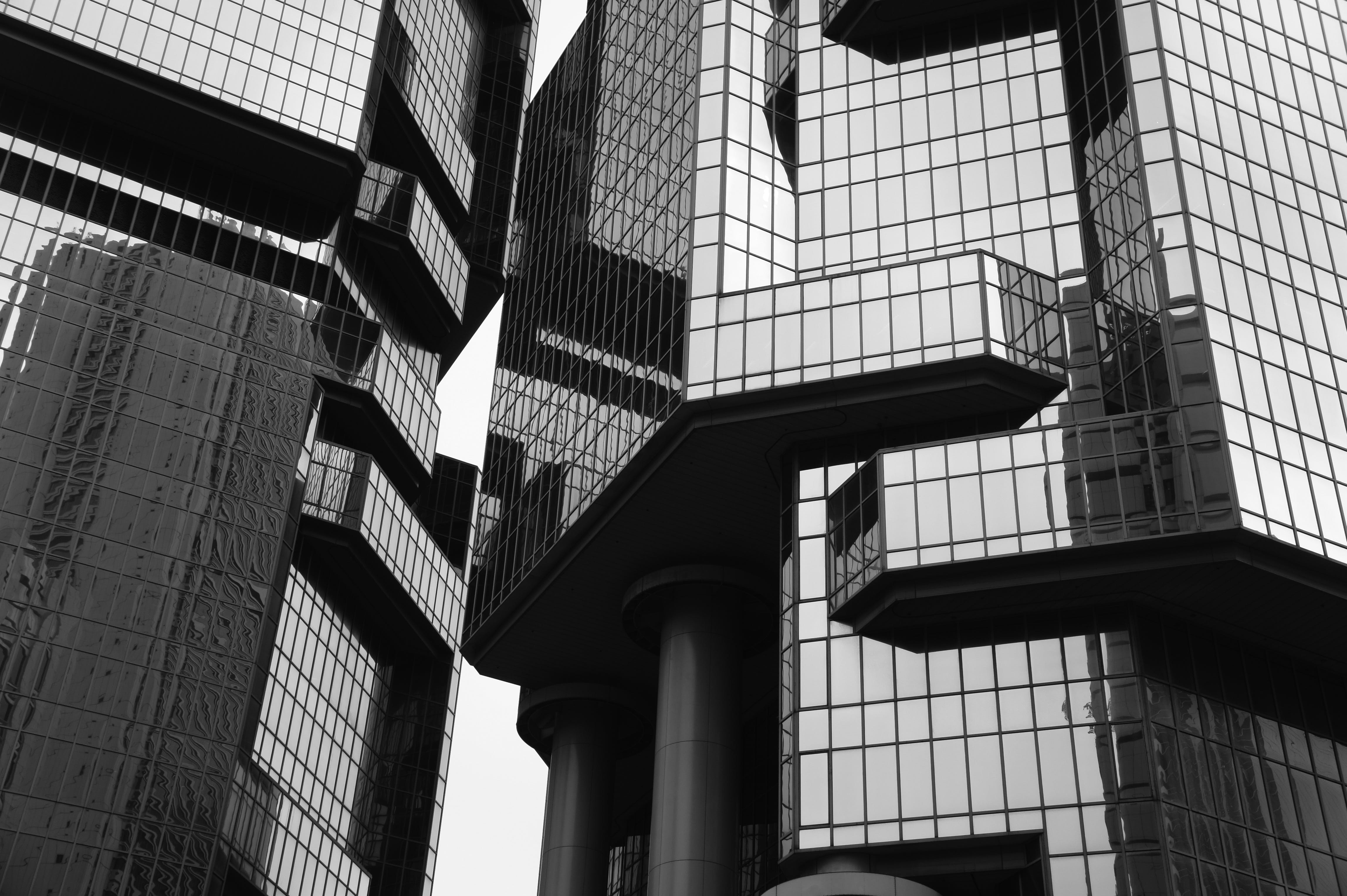 Grayscale Photo of Glass Building