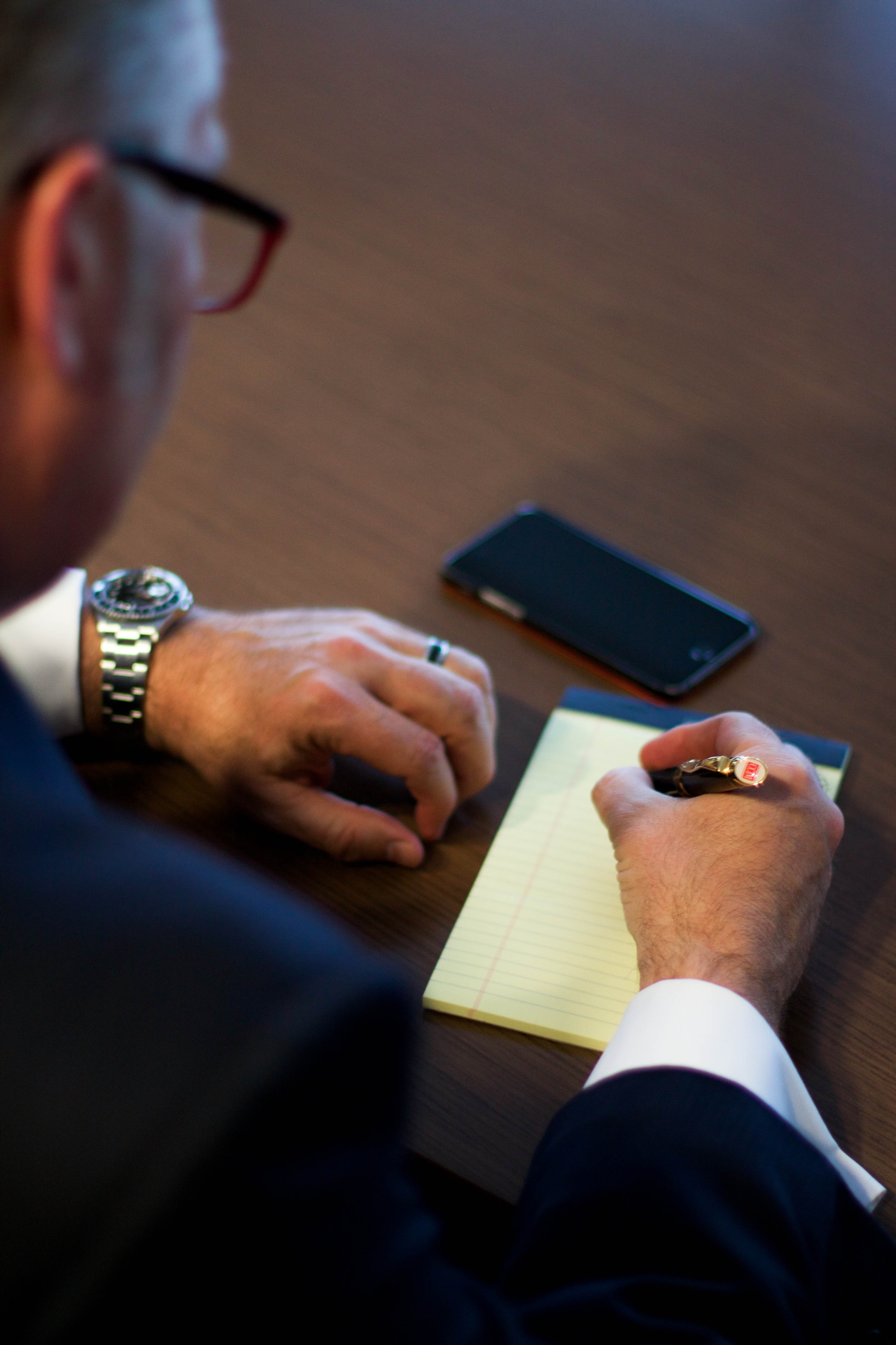Person Writing Notes on White Ruled Paper · Free Stock Photo