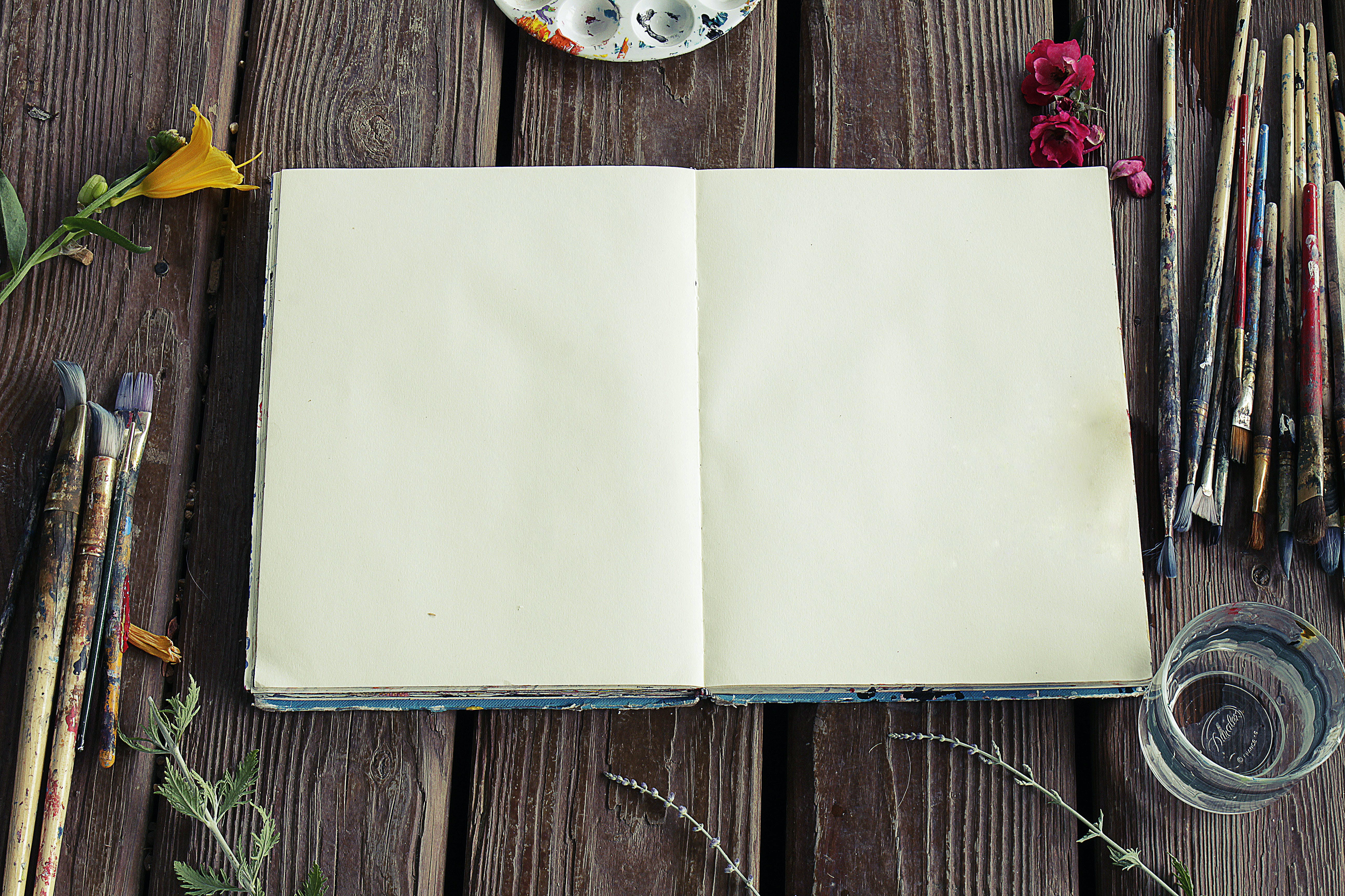 Photograph of Blank Sketchbook and Paint Brushes