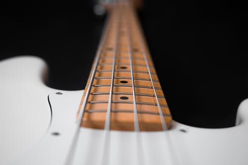 White and Brown Electric Bass Guitar