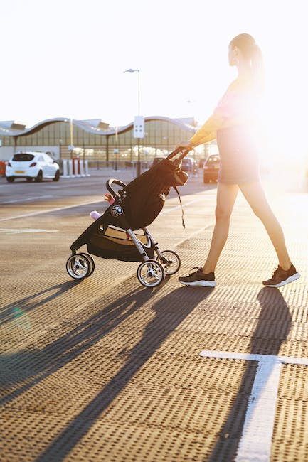 Photo of woman pushing a stroller