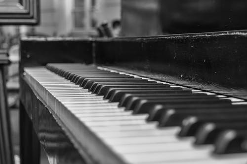 Close Up Shot of Upright Piano Grayscale Photo