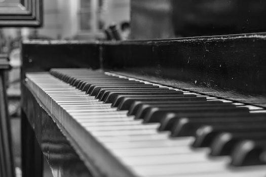 Close Up Shot of Upright Piano Grayscale Photo