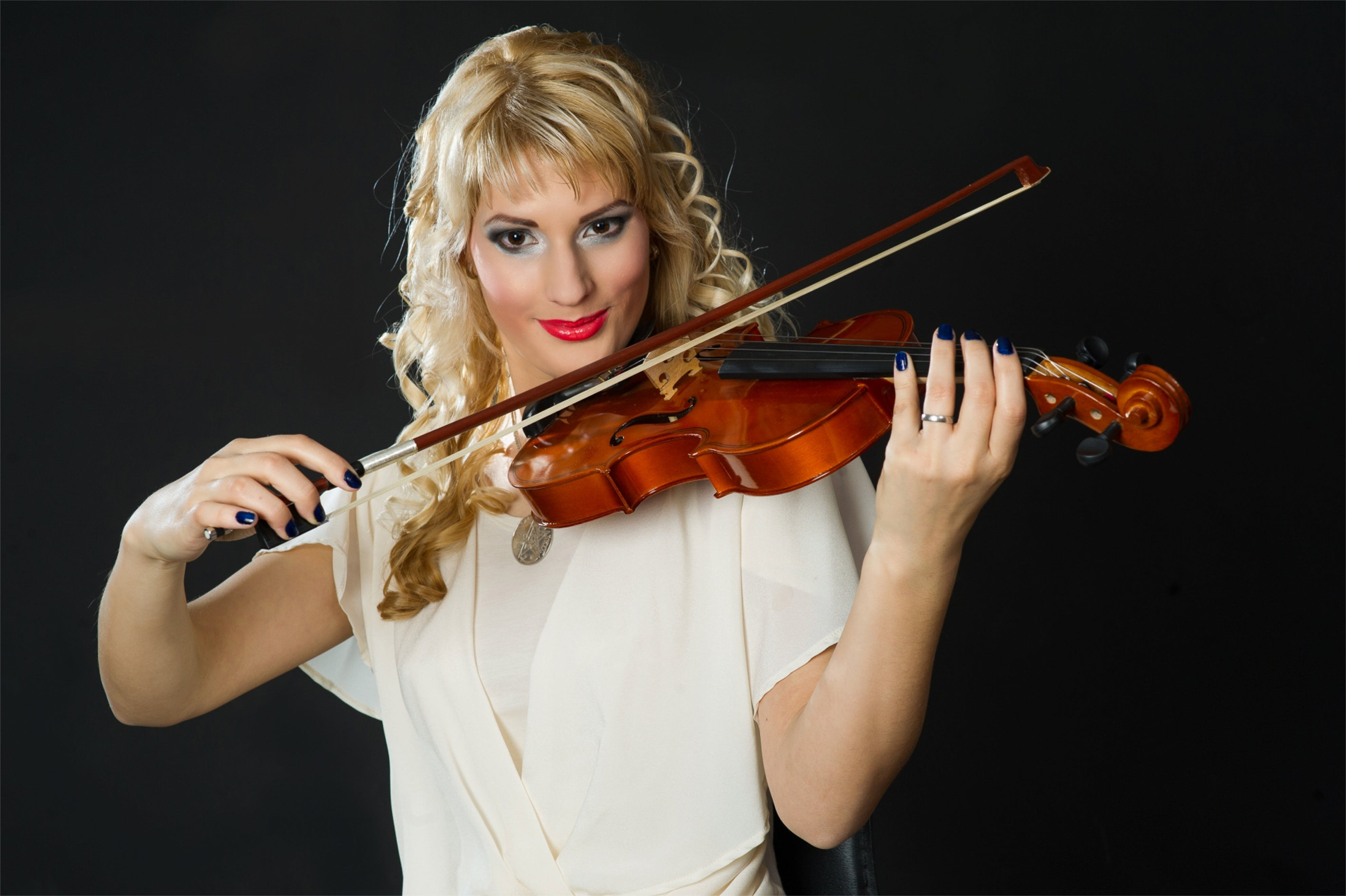Woman in White Blouse Playing Violin